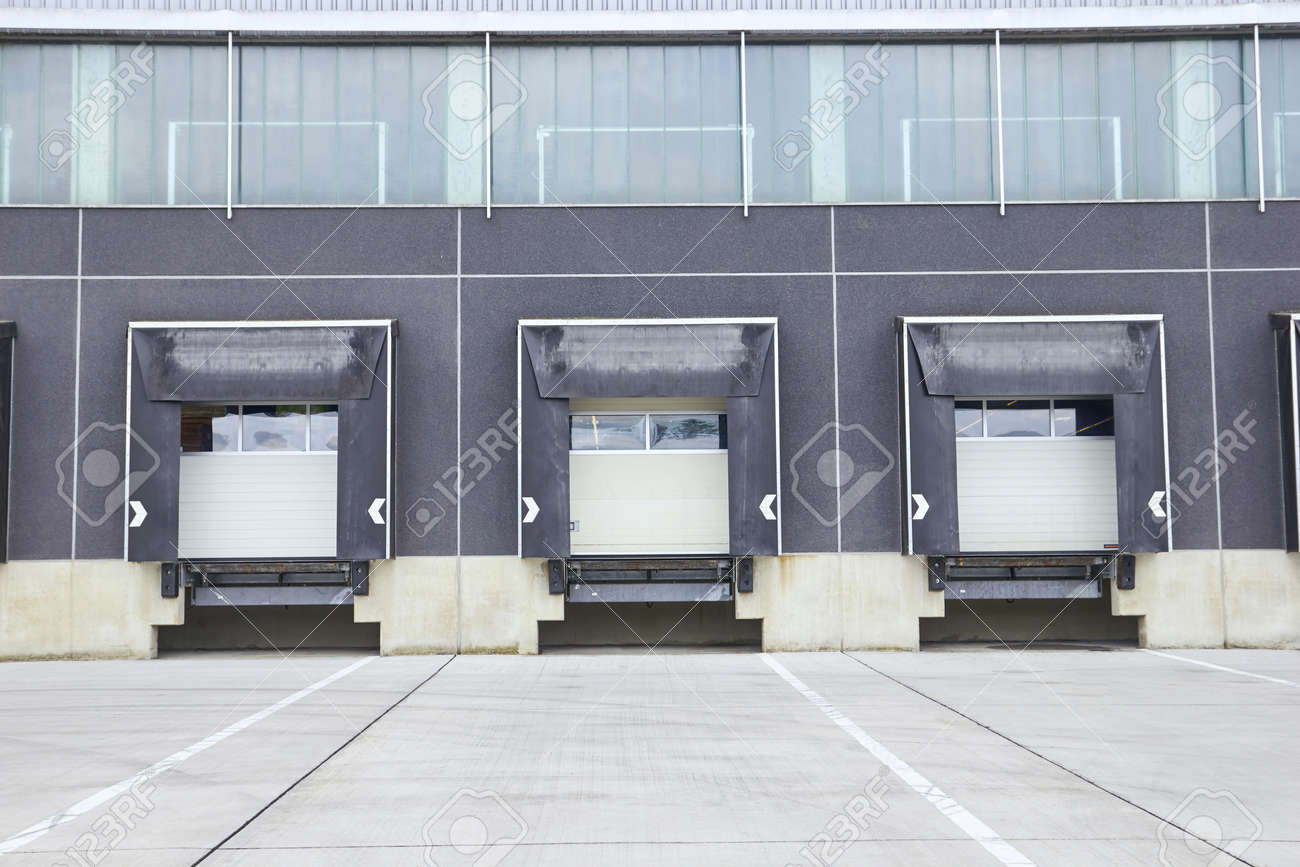 dock cargo doors at big warehouse building exterior Stock Photo - 71956698 & Dock Cargo Doors At Big Warehouse Building Exterior Stock Photo ...