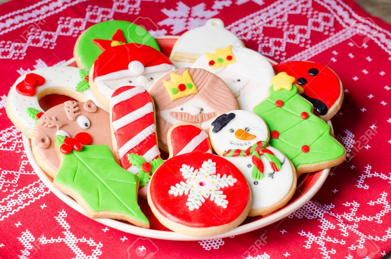 plate full of colorful christmas cookies decorated with fondant stock photo 64318185