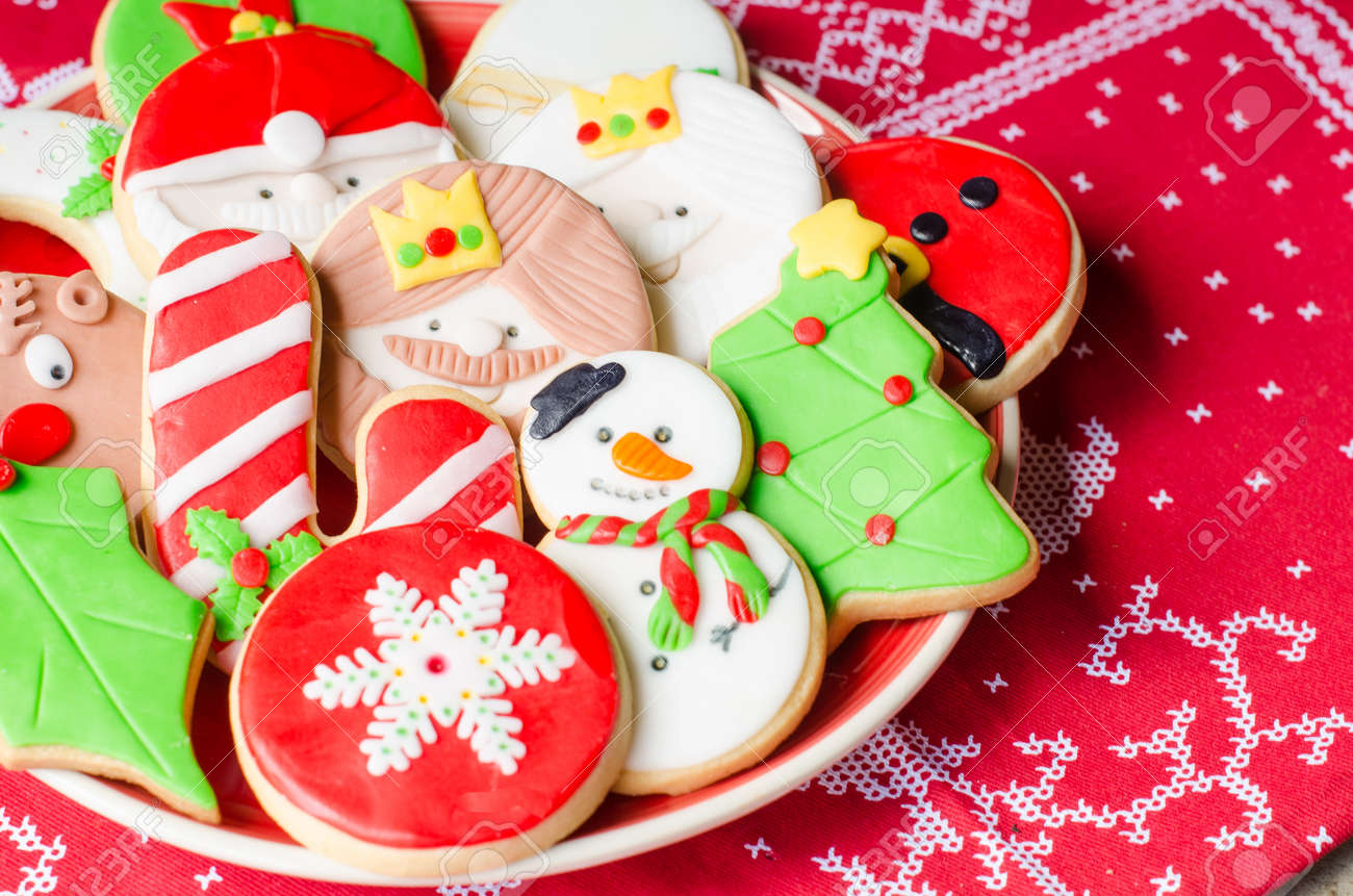 plate full of colorful christmas cookies decorated with fondant stock photo 64318190
