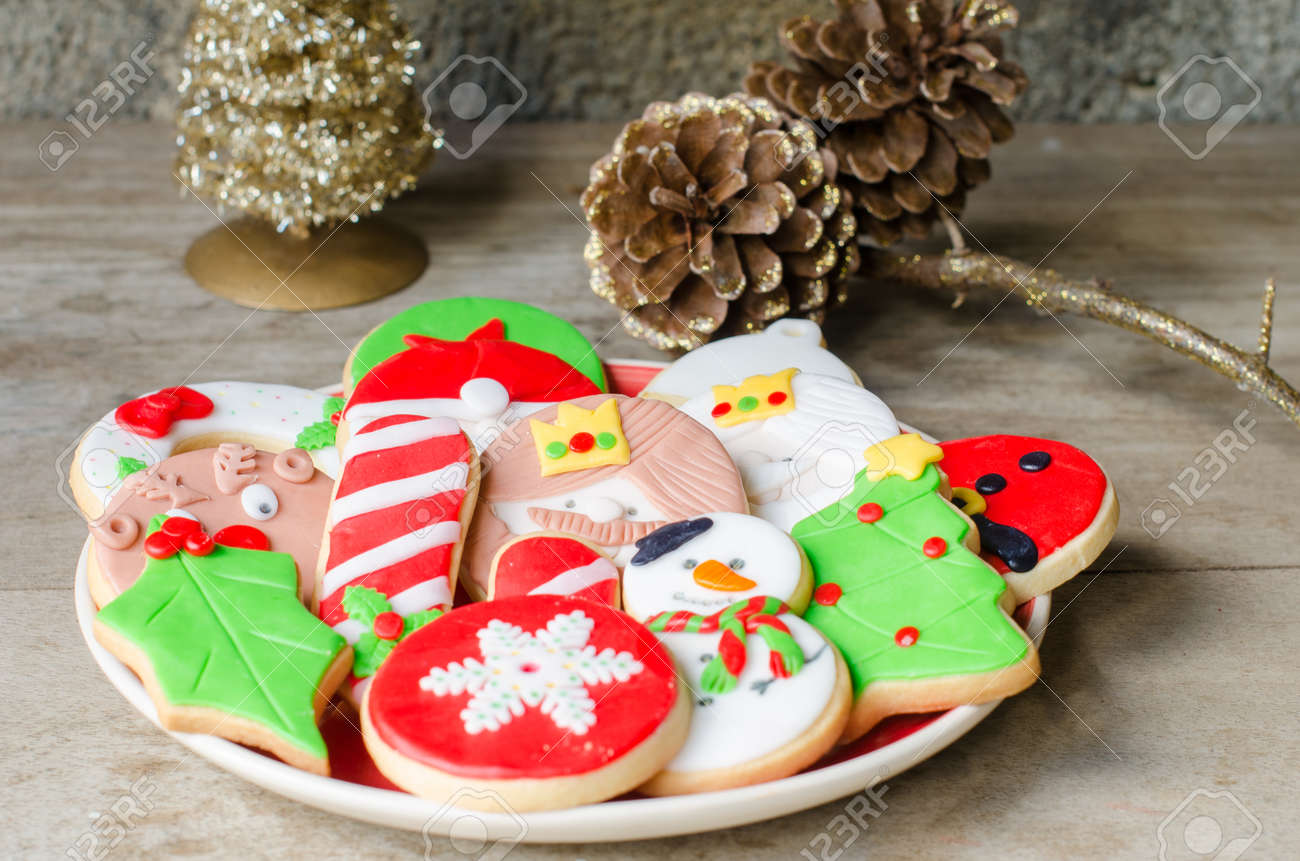 plate full of colorful christmas cookies decorated with fondant stock photo 64318193