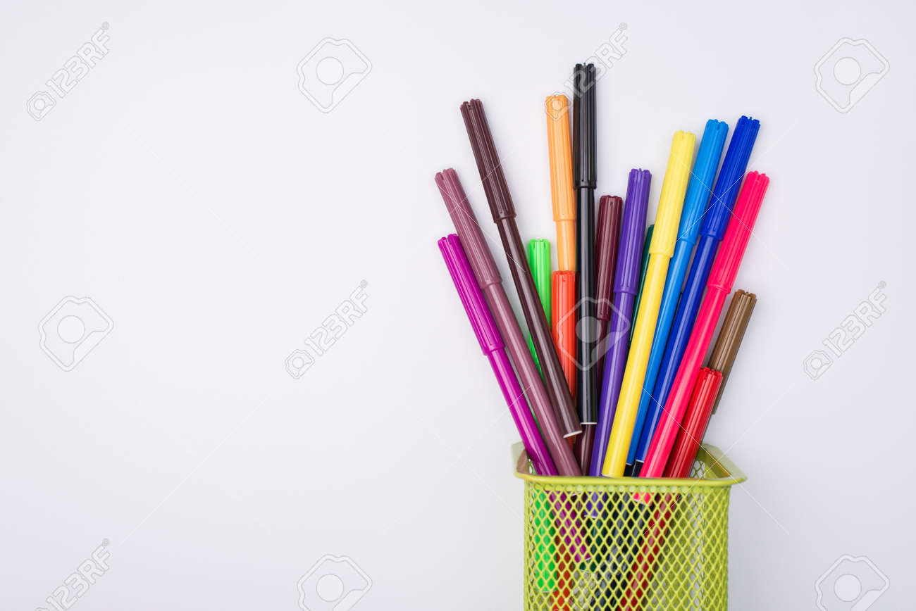 Drawing supplies concept. Top above overhead view flat-lay photo of colorful markers in pencil cup isolated on white background - 149127917