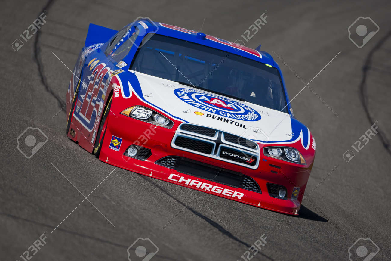 FONTANA, CA - MAR 23, 2012:  A.J. Almendinger (22) brings his race car through turn 4 during a practice session for the Auto Club 400 race at the Auto Club Speedway in Fontana, CA. Stock Photo - 12926389