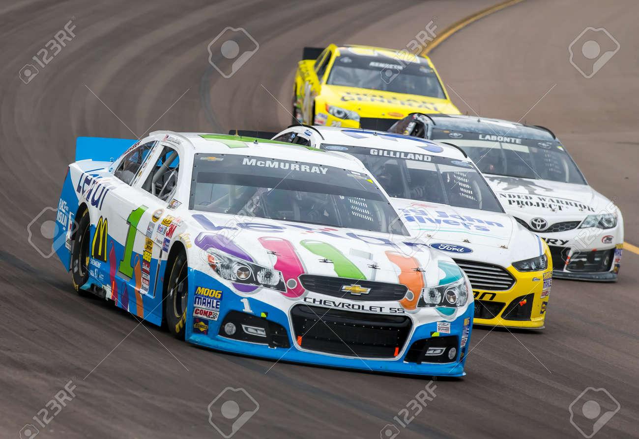 Avondale, AZ - Nov 10, 2013: Jamie McMurray (1) brings his race car through the turns during the AdvoCare 500 race at the Phoenix International Raceway in Avondale, AZ. - 24047920