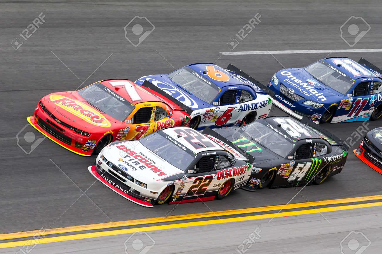 Daytona Beach, FL - Feb 22, 2014: Regan Smith (7) holds off Brad Keselowski (22), Trevor Bayne (6), Kyle Busch (54) and the rest of the field to win the DRIVE4COPD 300 at Daytona International Speedway in Daytona Beach, FL. - 26843057