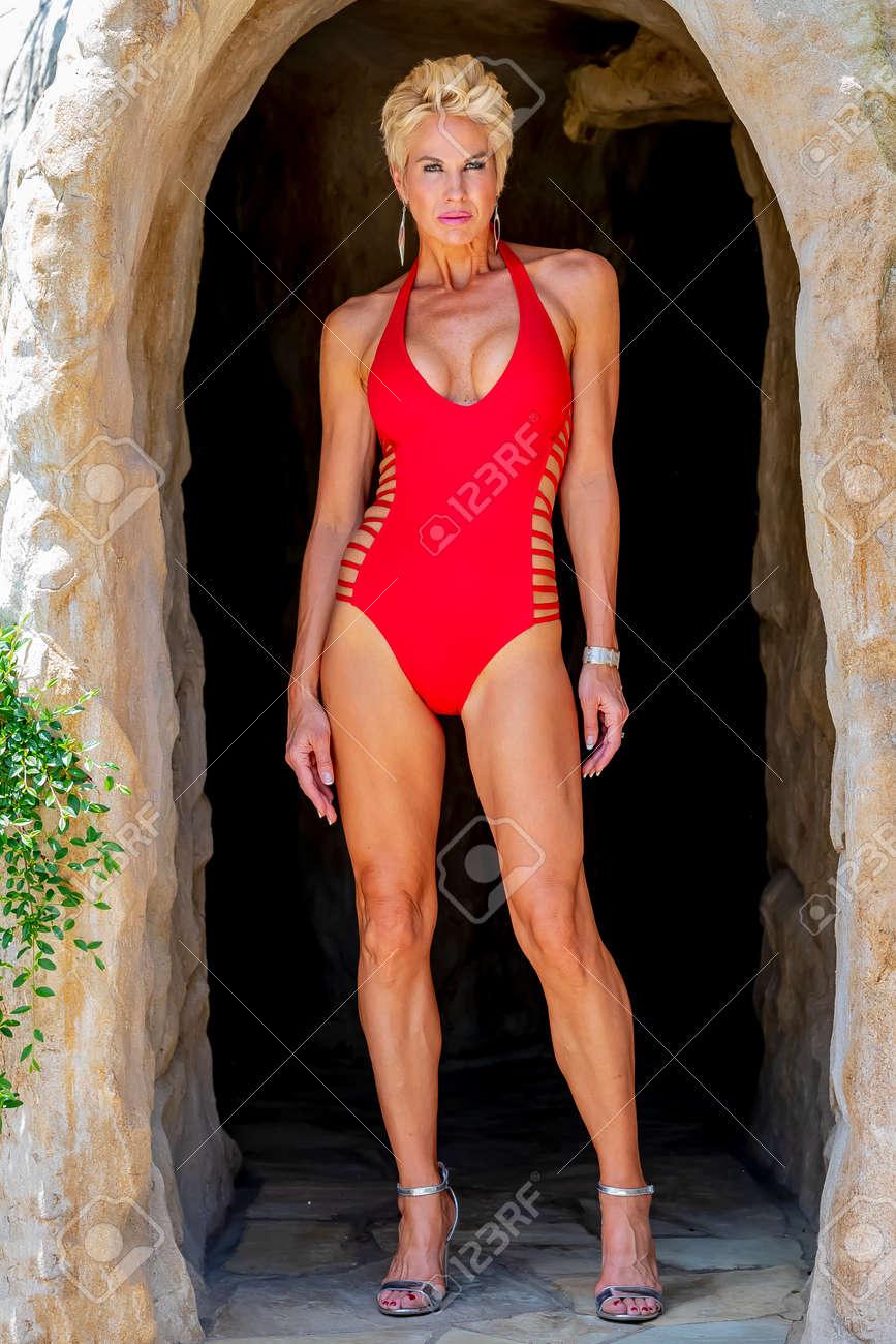 Mature mom bikini A Beautiful Mature Blonde Bikini Model Poses Outdoors Near A Swimming Pool Stock Photo Picture And Royalty Free Image Image 104449644