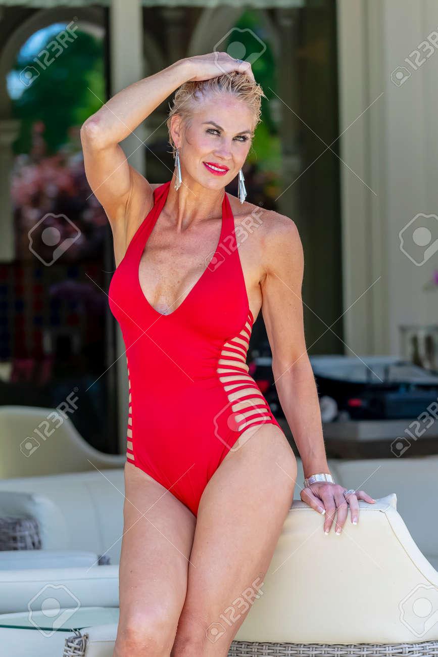 Mature mom bikini A Beautiful Mature Blonde Bikini Model Poses Outdoors Near A Swimming Pool Stock Photo Picture And Royalty Free Image Image 104449647