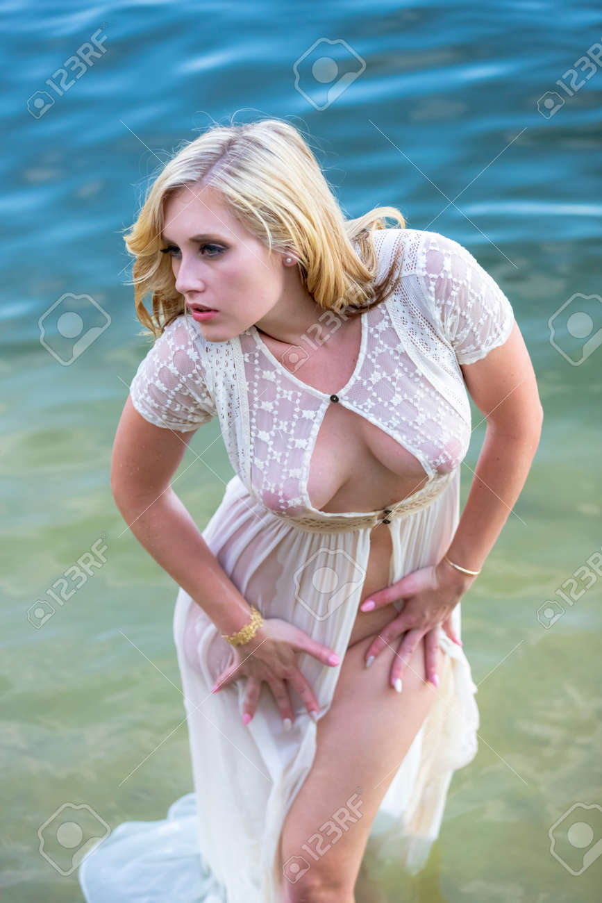 A gorgeous blonde model enjoys the lake on a summers day - 130423474
