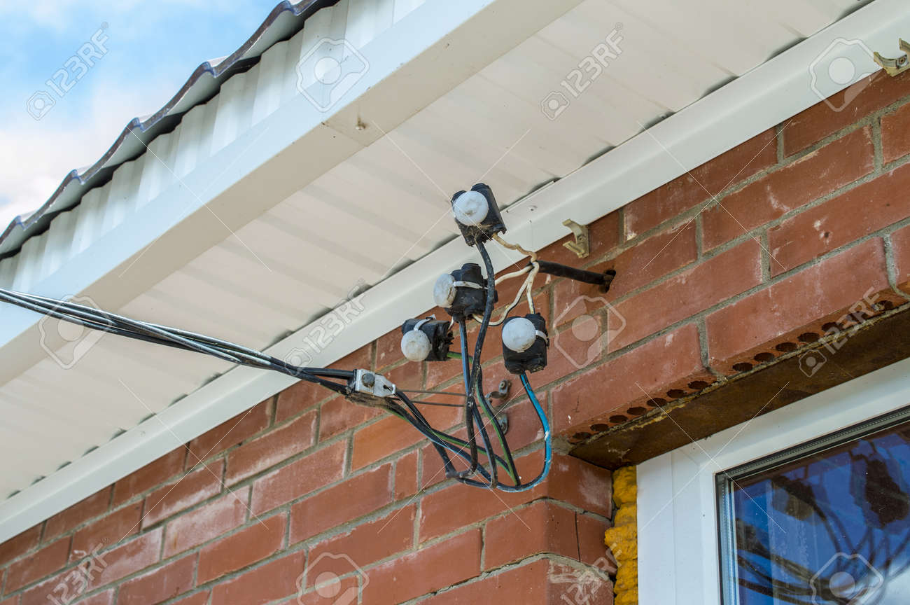Sensational Input Of Electric Wires On A Brick Wall Stock Photo Picture And Wiring 101 Akebretraxxcnl