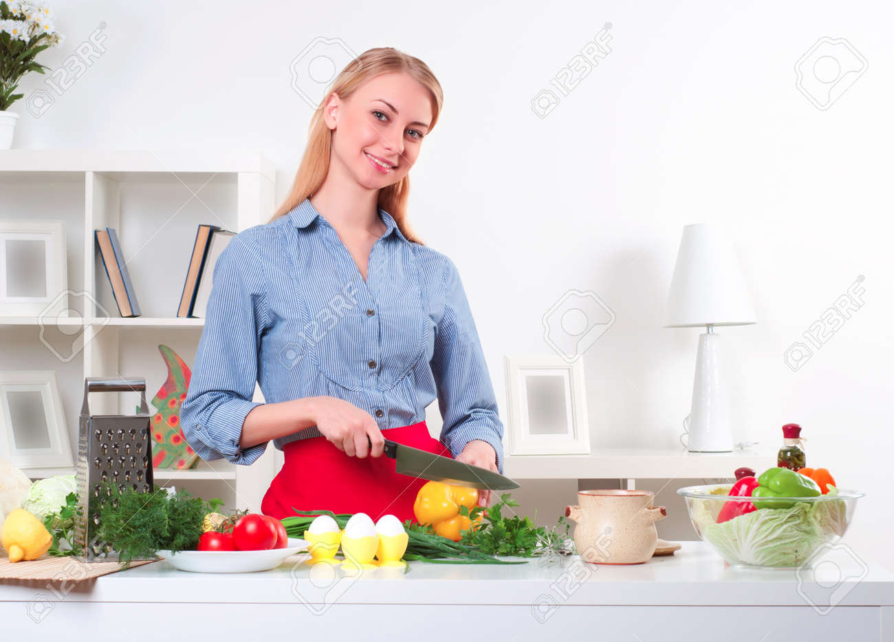 portrait beautiful woman cooking vegetables, healthy lifestyle Stock Photo - 16976596