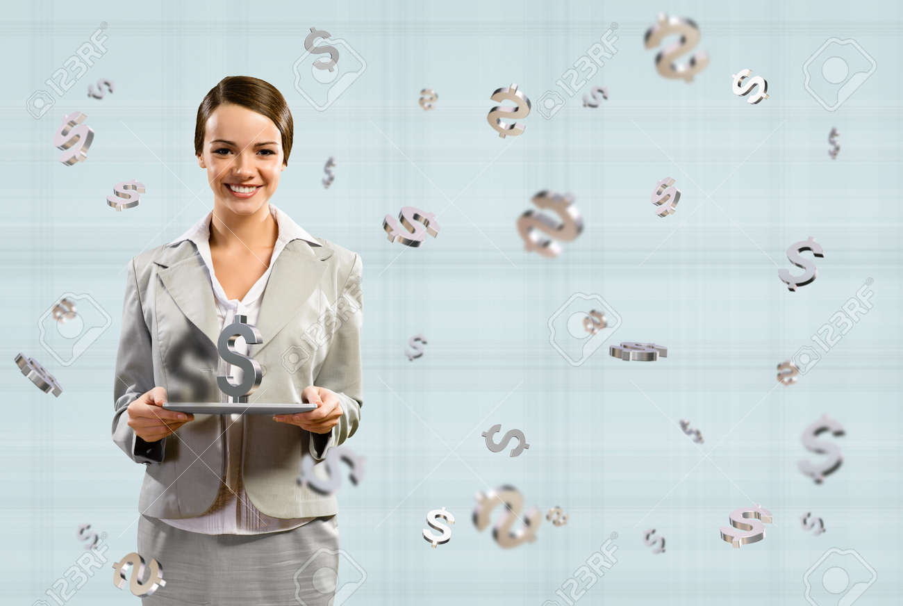 attractive business woman smiling and holding a tablet, with a dollar sign, concept of business success Stock Photo - 17283384
