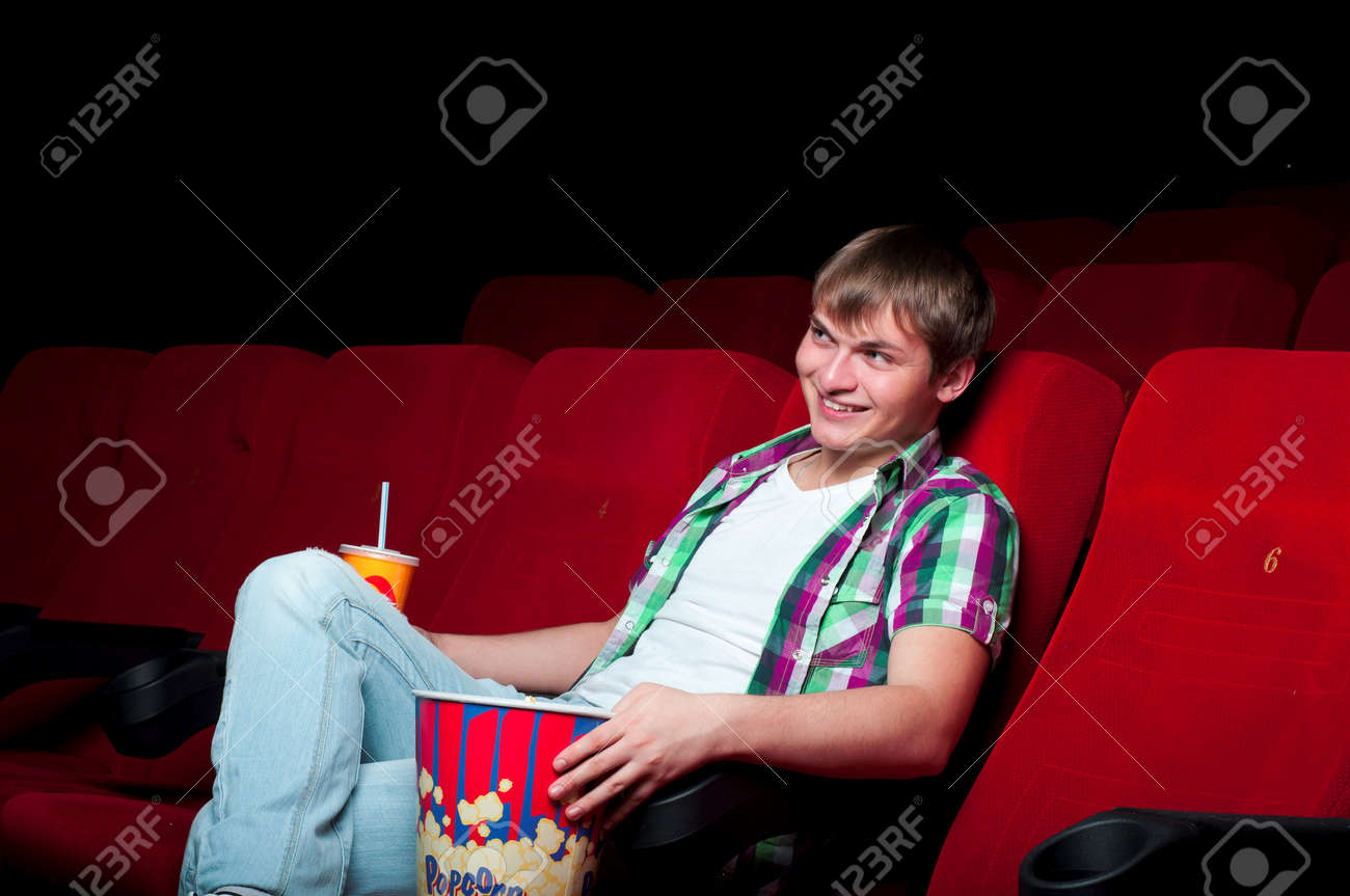 man in a movie theater, watching a movie and drink a drink Stock Photo - 17288623
