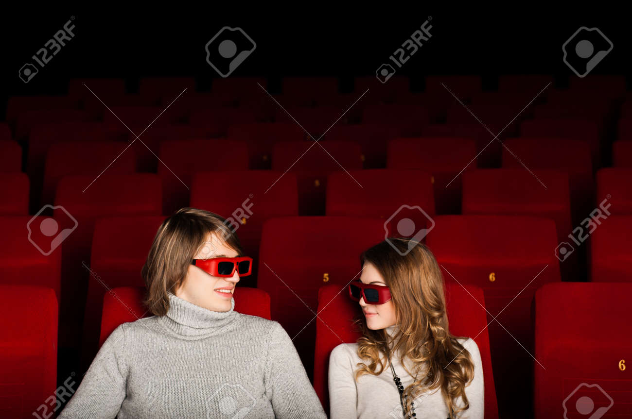 young couple in the cinema to enjoy the movie Stock Photo - 17478038