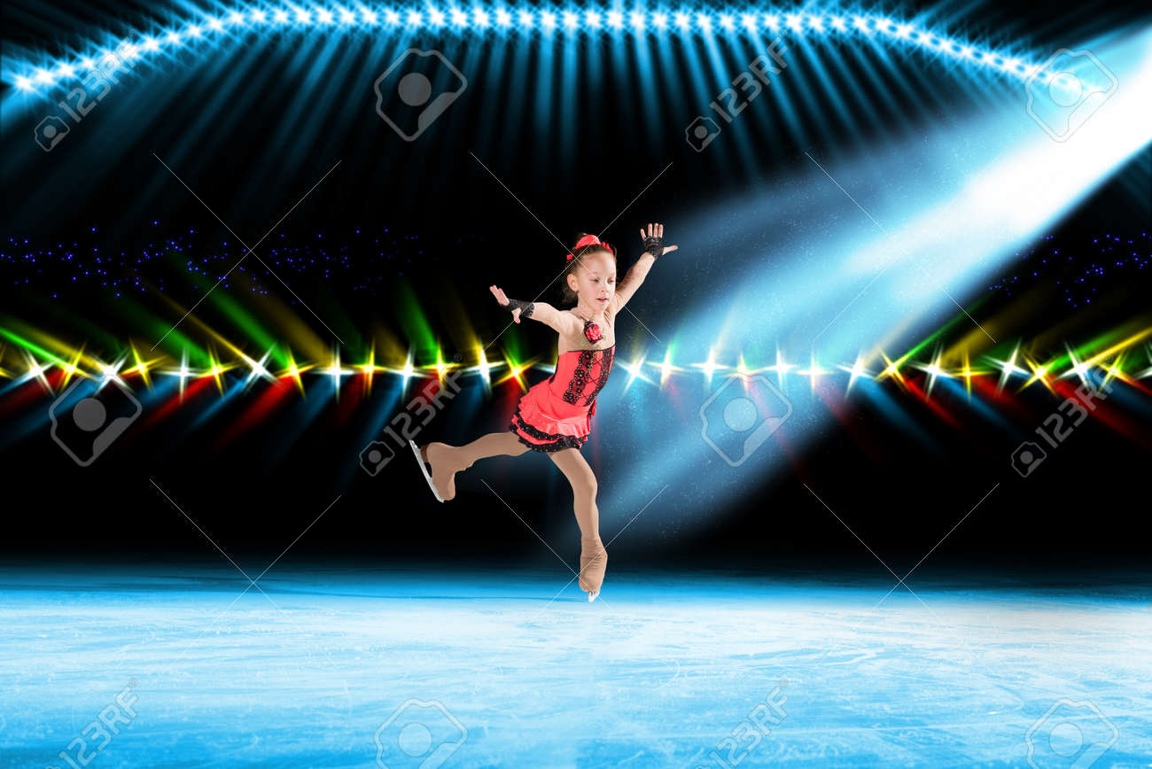 young skater performs on the ice in the background lights lighting Stock Photo - 17567239