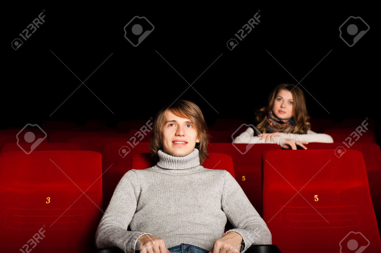young man and woman in the cinema to enjoy the movie Stock Photo - 17567258