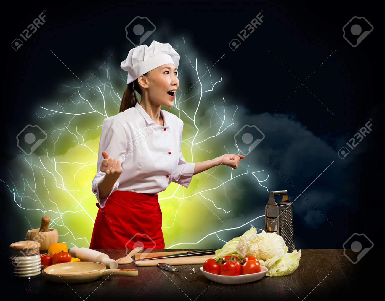 Asian woman furious chef shouting with clenched fists, lightning and flashes of light Stock Photo - 18200569