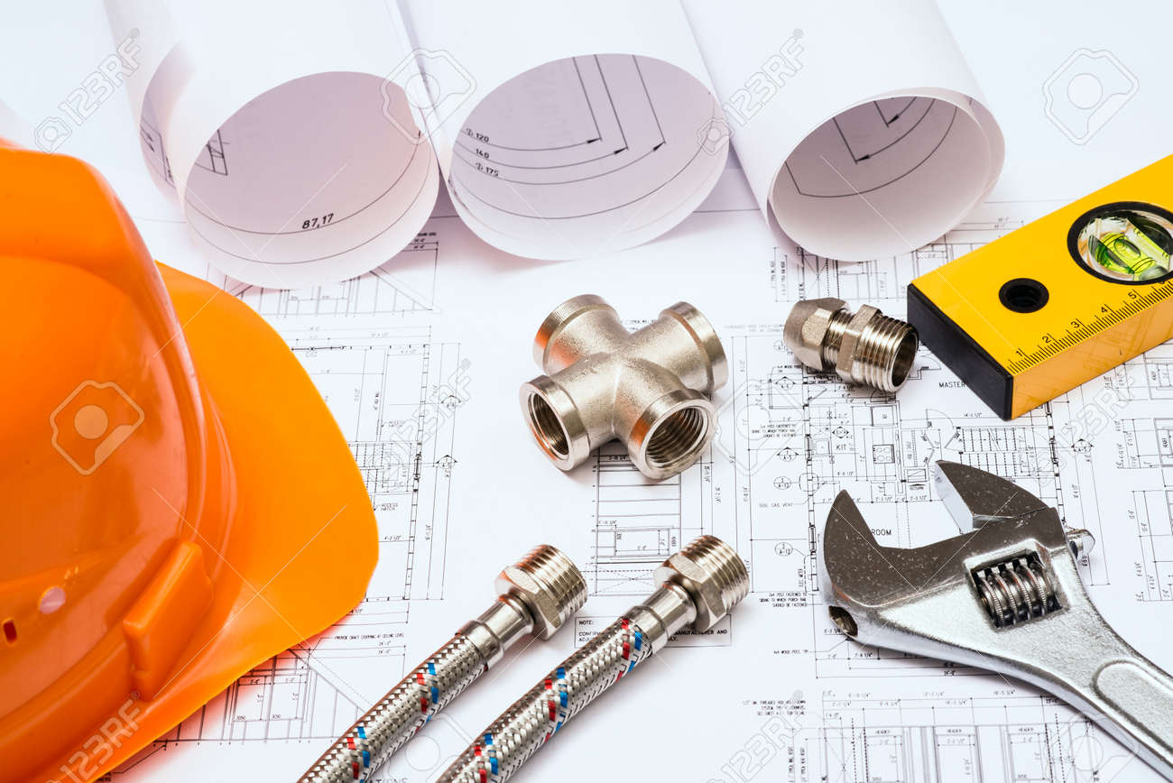 Plumbing And Drawings Are On The Desktop Workspace Engineer Stock Photo