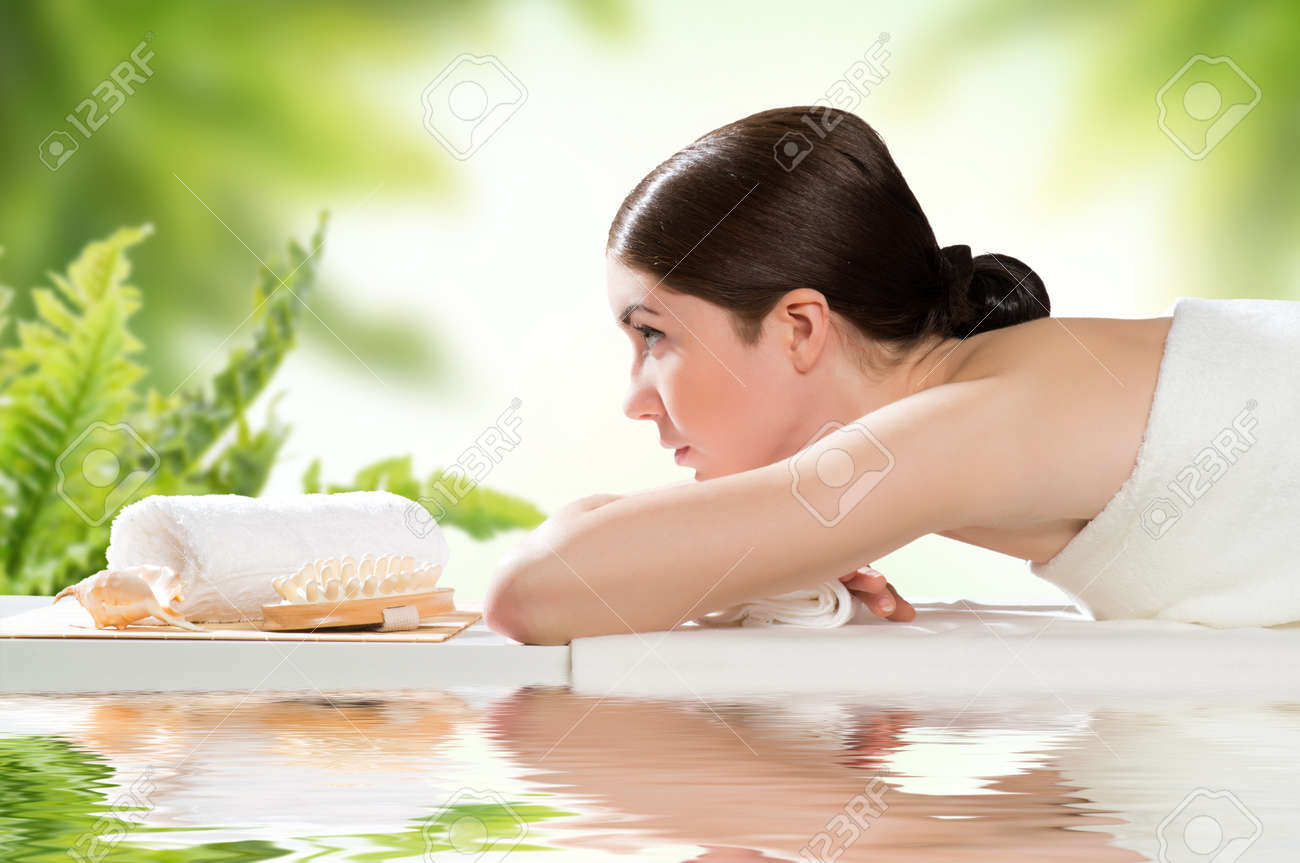 beautiful spa woman lying on the couch, gets pleasure Stock Photo - 19056103