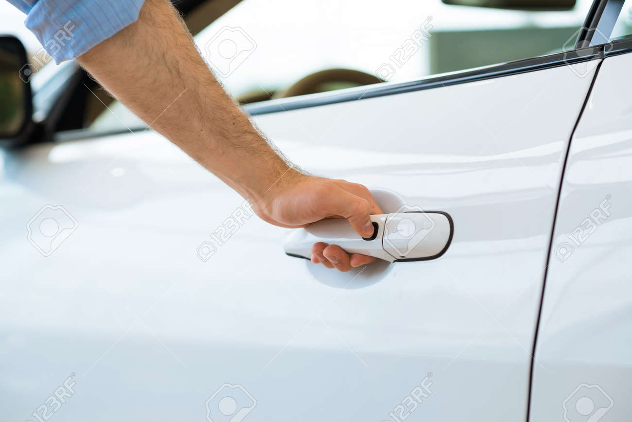 man opens the door to a new car, car inspection in the showroom Stock Photo - 19715804