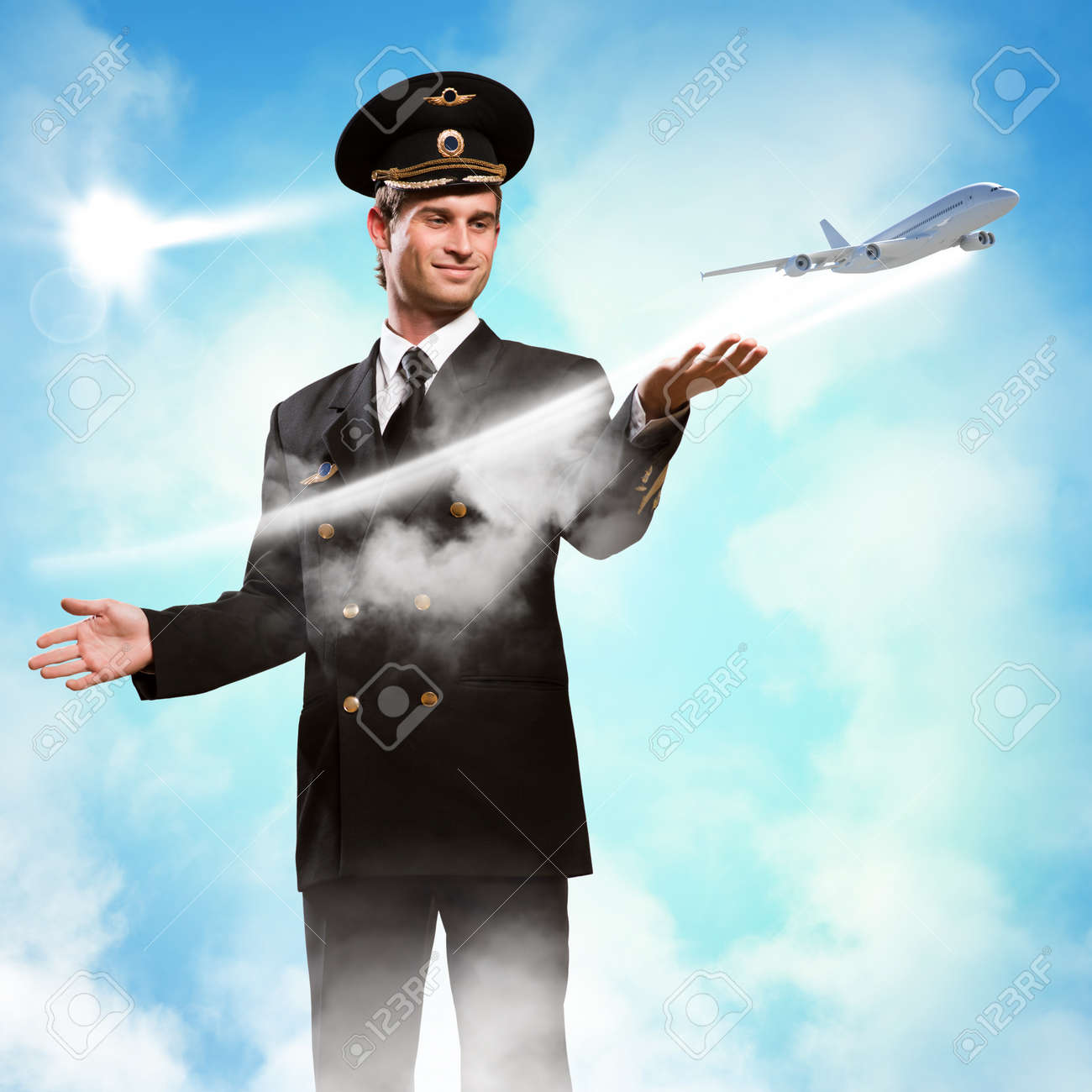 pilot in the form of extending a hand to a flying airplane on the background of clouds and sun Stock Photo - 20678461