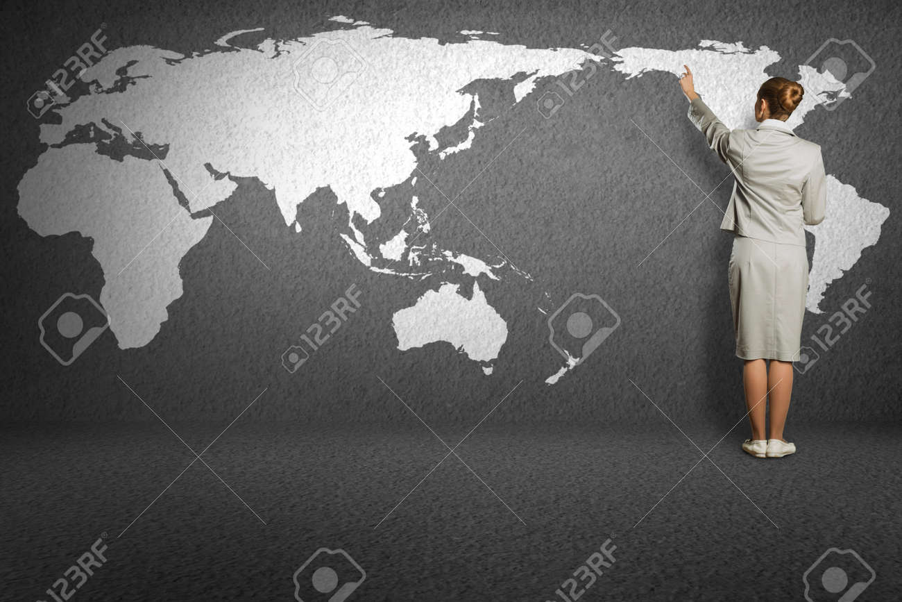 business woman draw a map on the wall, a global business Stock Photo - 23164383