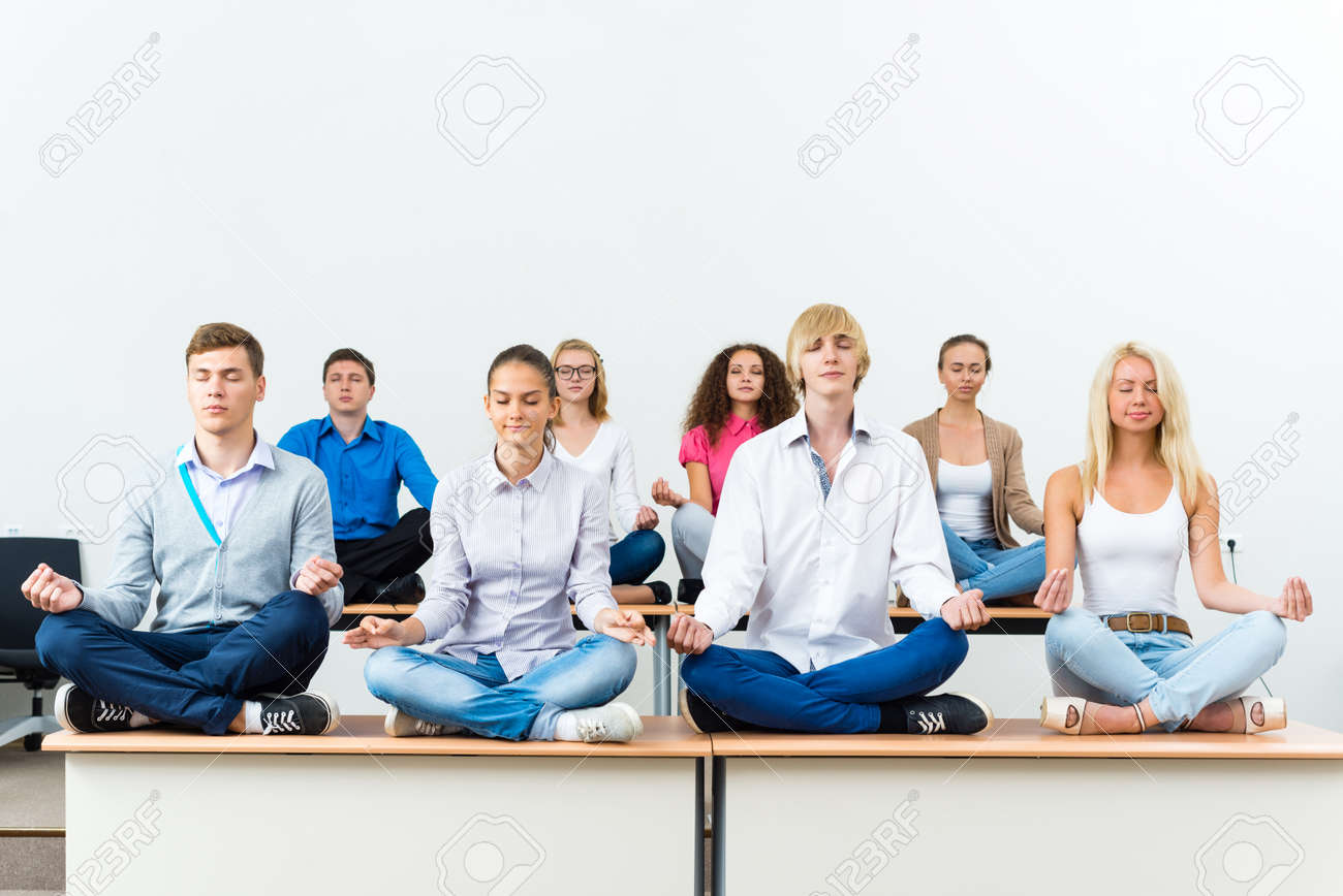 meditation in office. group of young people meditating in office at desk meditation stock photo 26869573 o