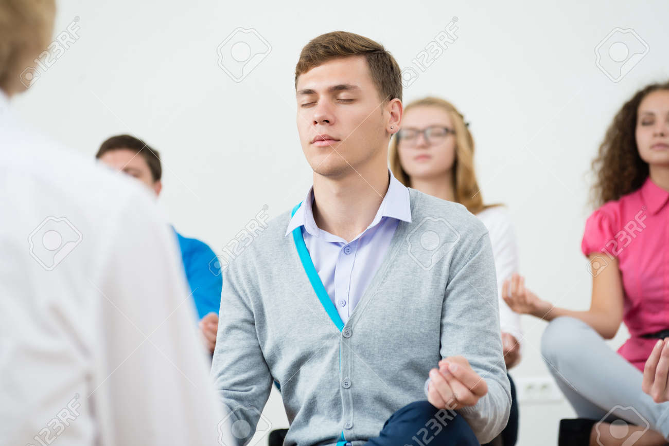 meditation in office. group of young people meditating in office at desk meditation stock photo 27355122 s