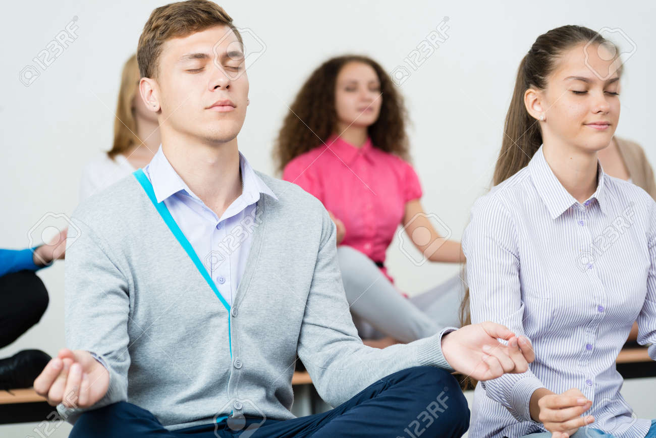 Group Of Young People Meditating In Office At Desk, Group Meditation Stock  Photo   28179284