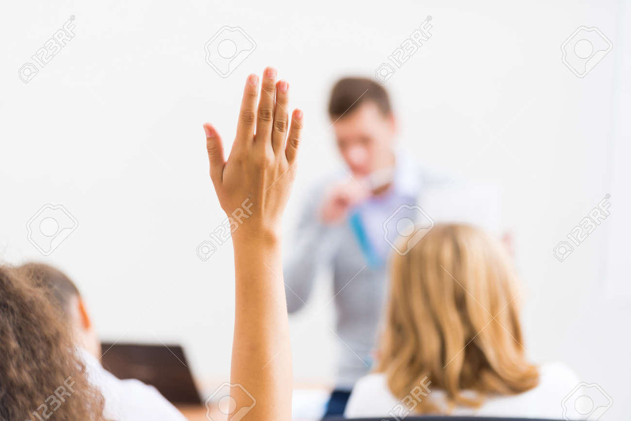 image of a female hand raised in university classroom - 34889174