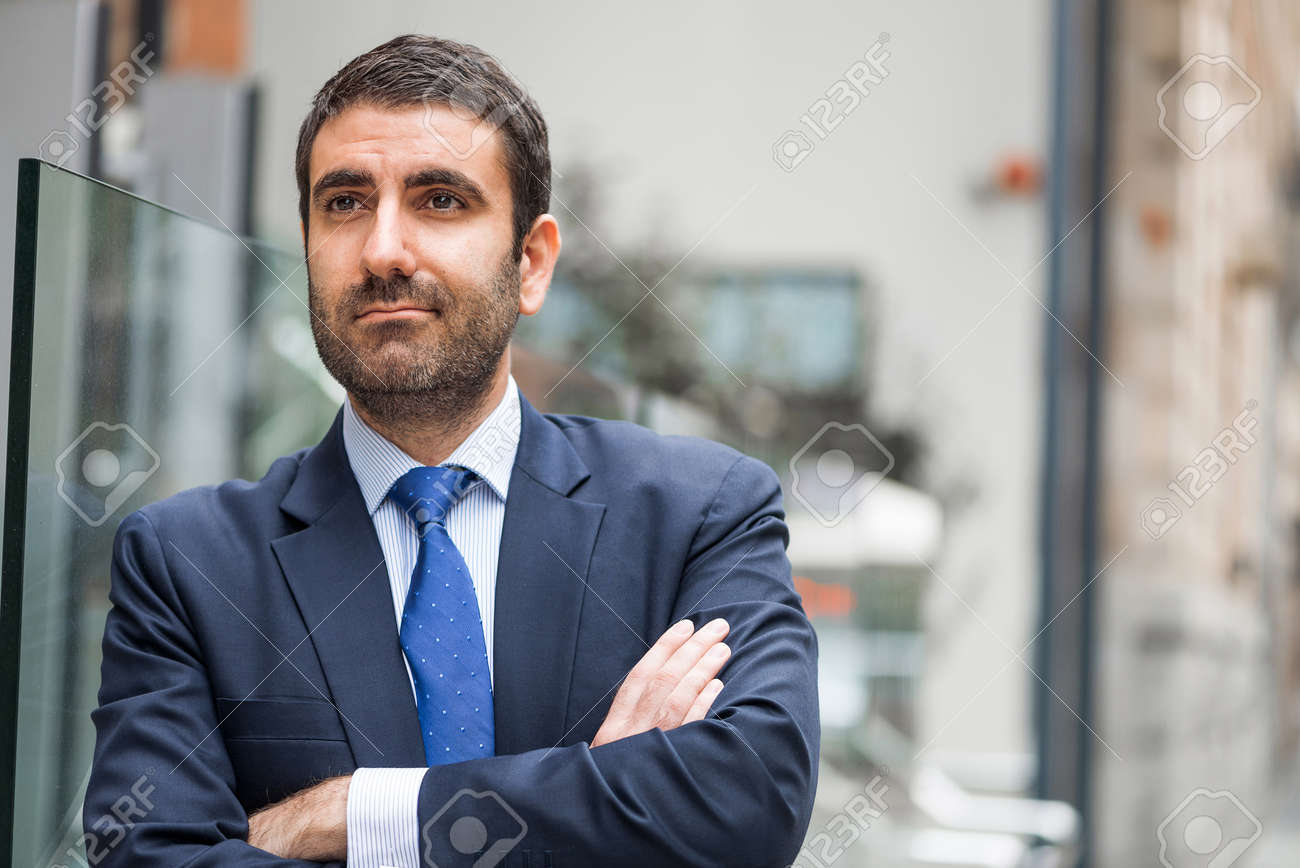 Happy Arab Businessman Standing With Arms Crossed On Chest