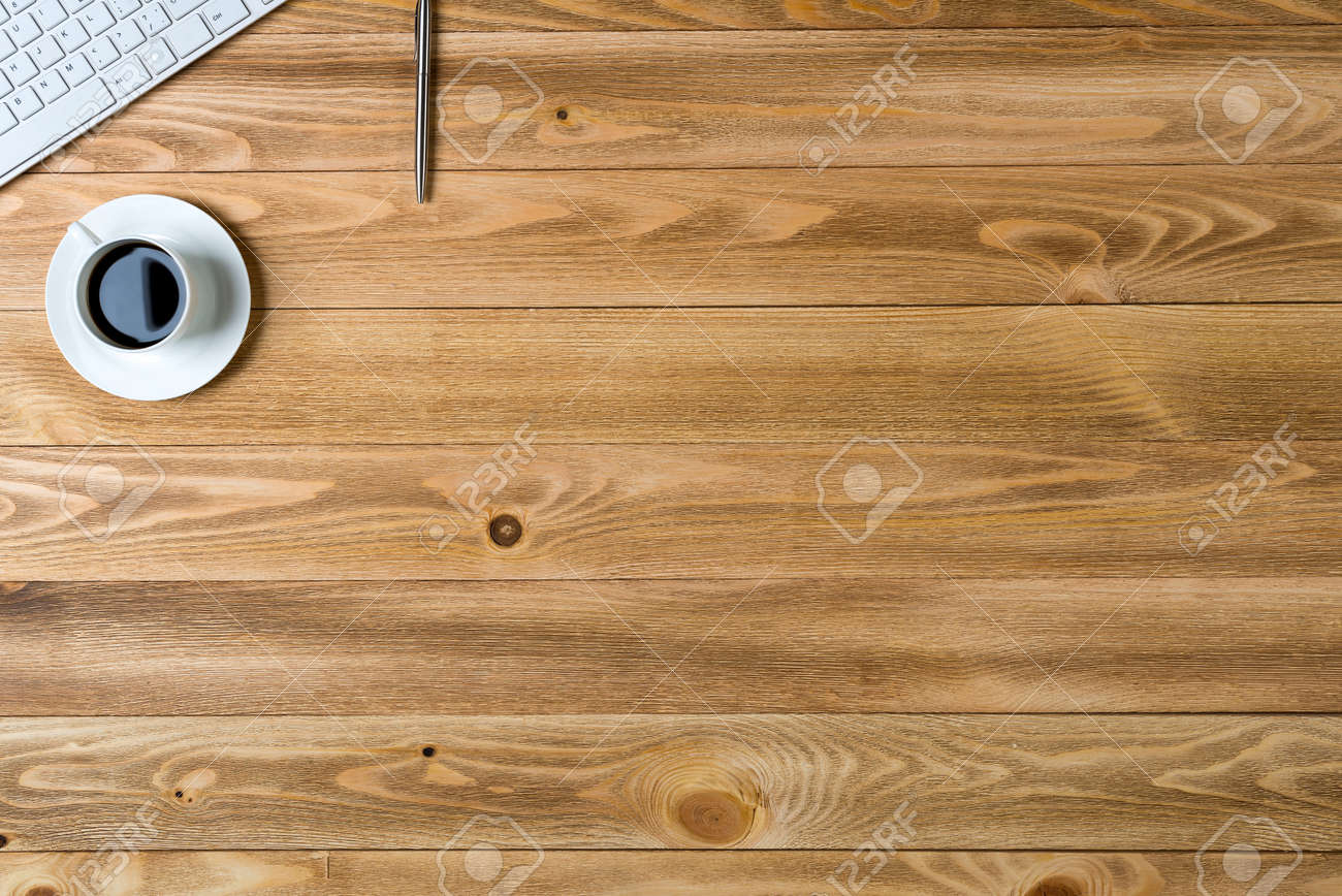 table top view. table top: top view of workplace with cup keyboard pencil on wooden stock photo a
