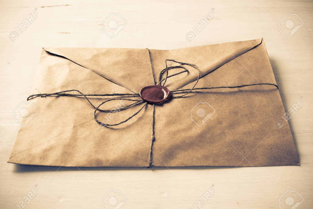 Old Letter Envelope With Wax Seal On Wooden Surface Stock Photo