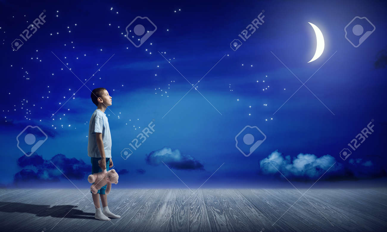 Kids at night with moon royalty free stock photography image - Cute Kid Boy Wearing Pajamas With Bear Toy In Hand Stock Photo 55958490