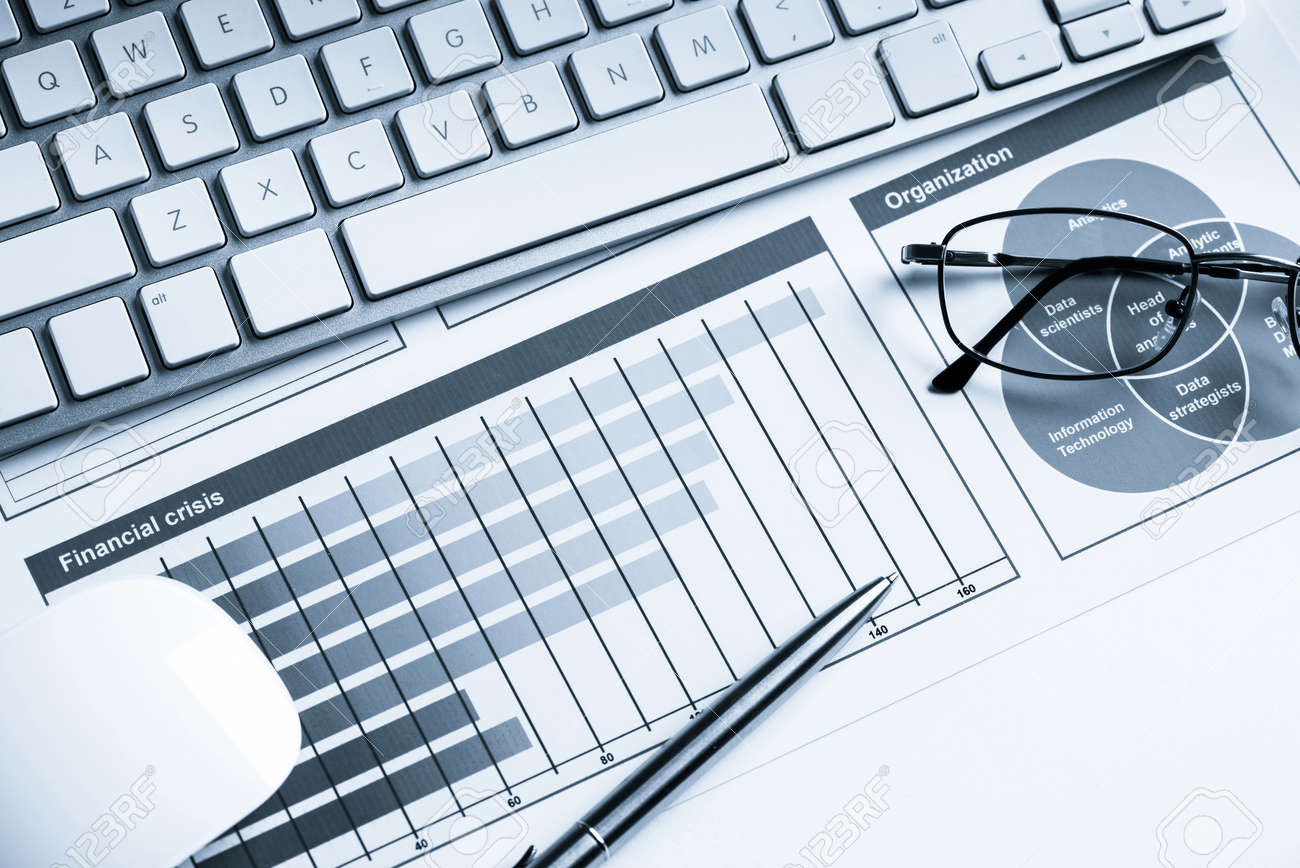 business workplace with keyboard mouse and papers with graphsbusiness workplace with keyboard mouse and papers with graphs and diagrams stock photo 67128516
