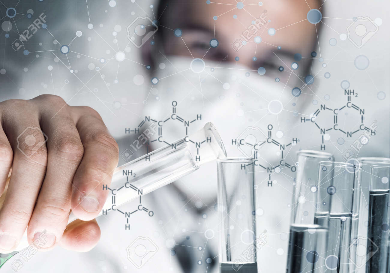 Handsome scientist making research over dna molecule structure - 80123058