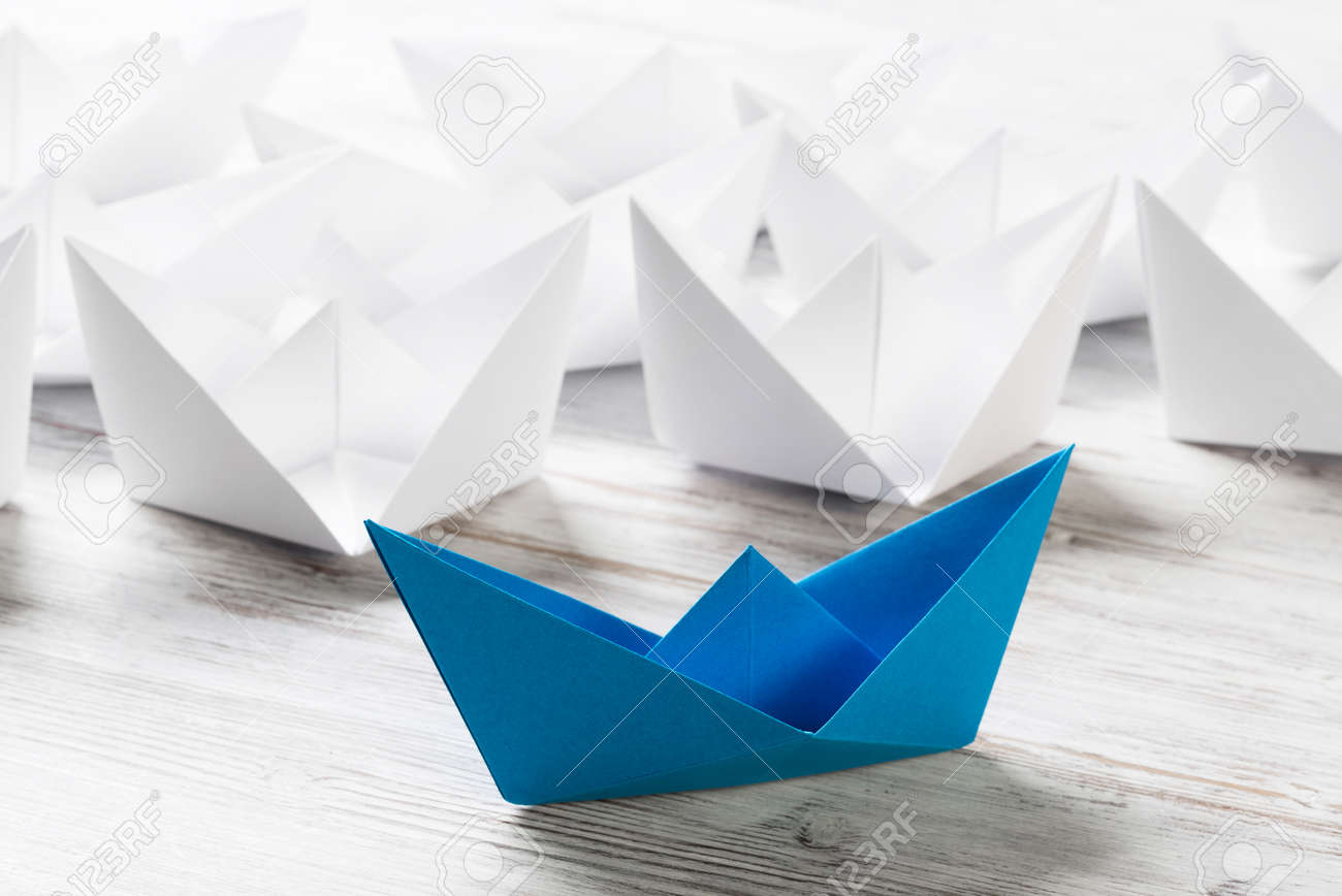 Set Of Origami Boats On Wooden Table Stock Photo Picture And
