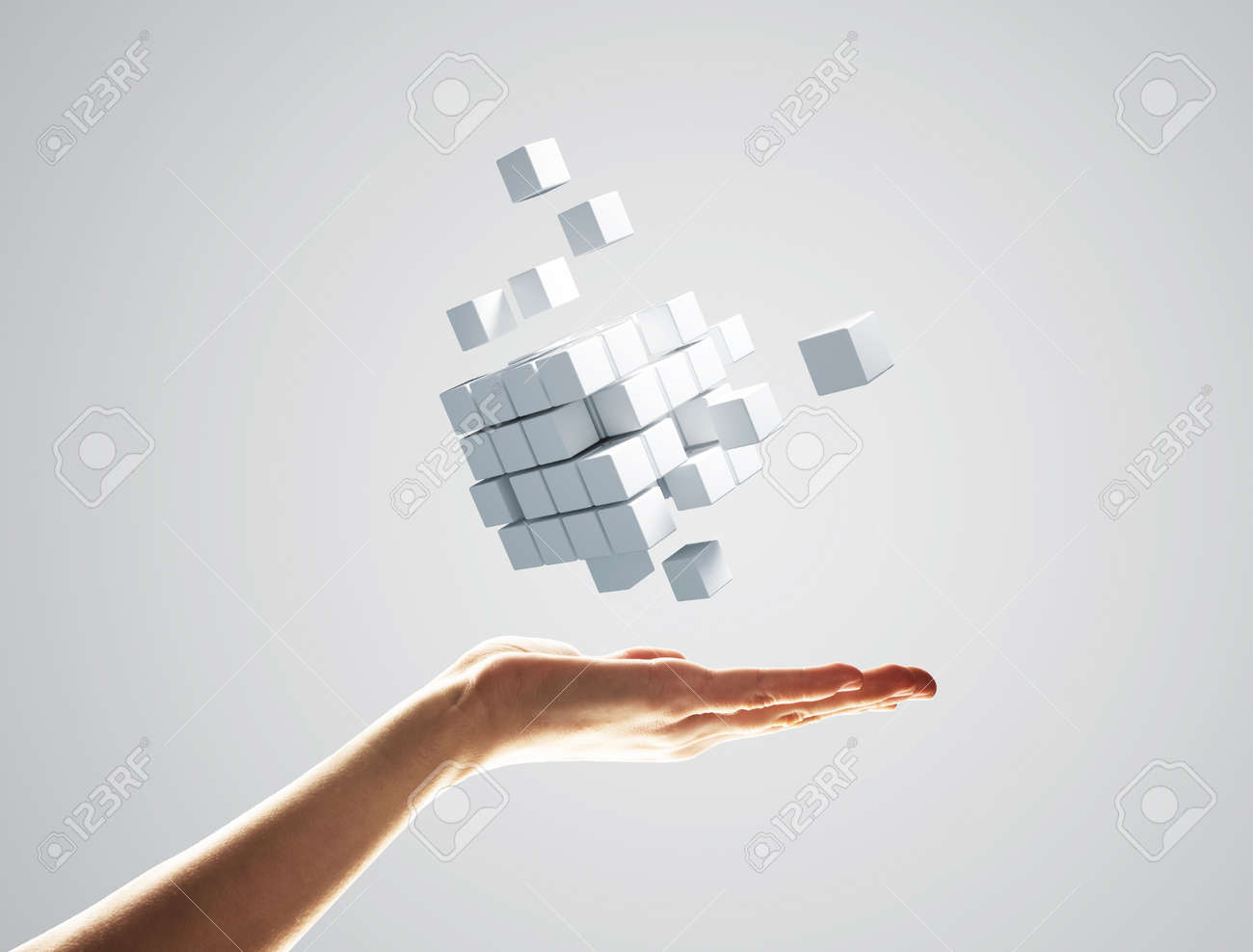 Close of businessman hand holding cube figure as symbol of innovation. 3D rendering - 108967535