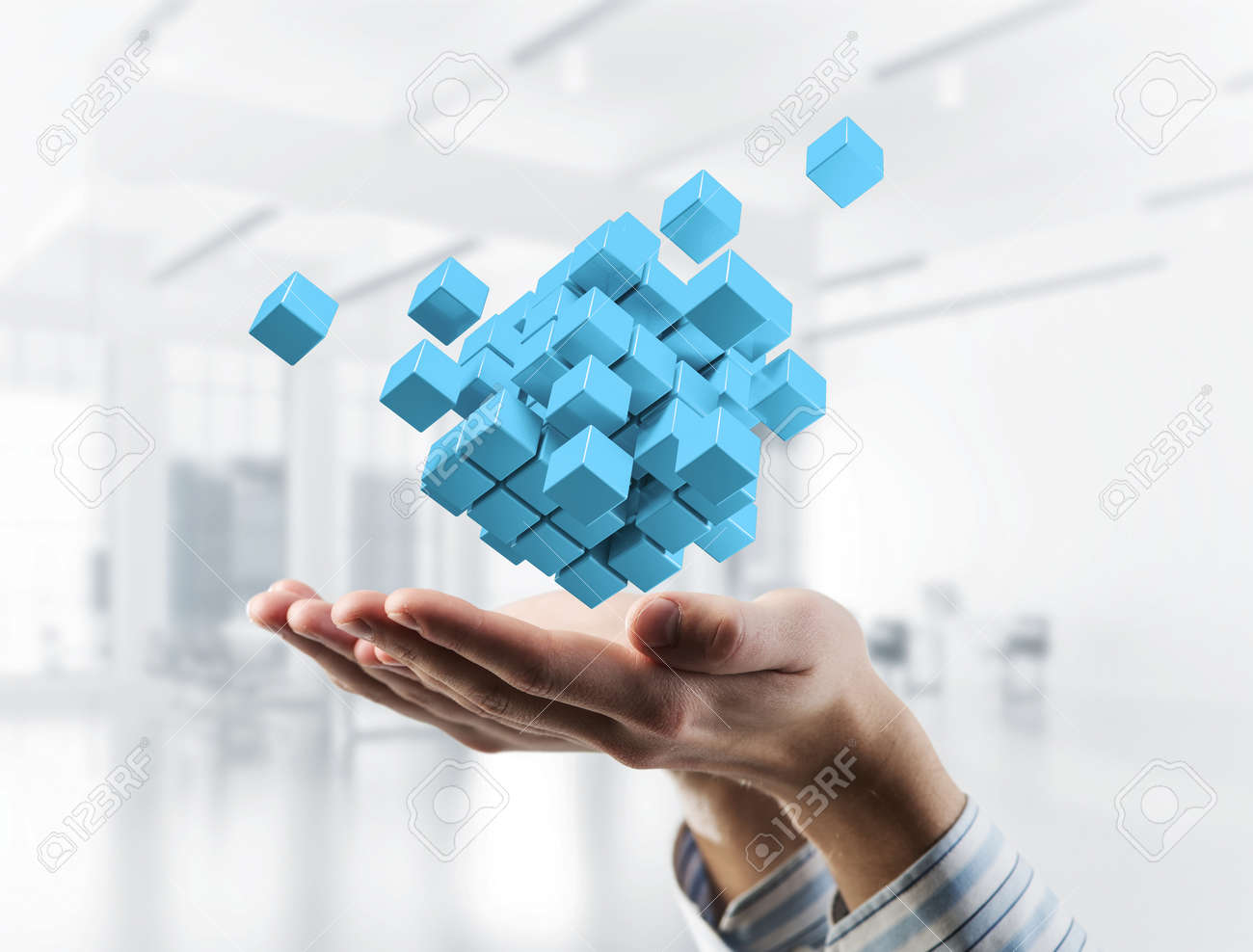 Close of businessman hand holding cube figure as symbol of innovation. 3D rendering - 113927636