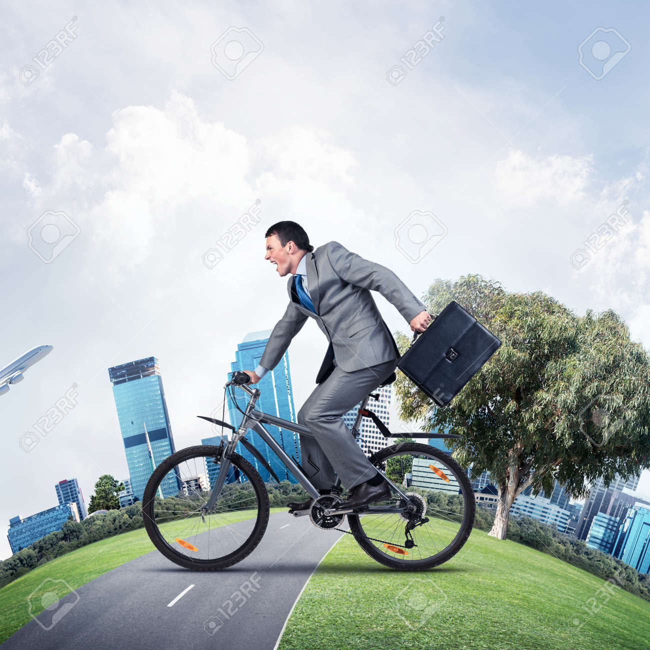 Young Man Riding Bicycle On Road Businessman On Bike Hurry To