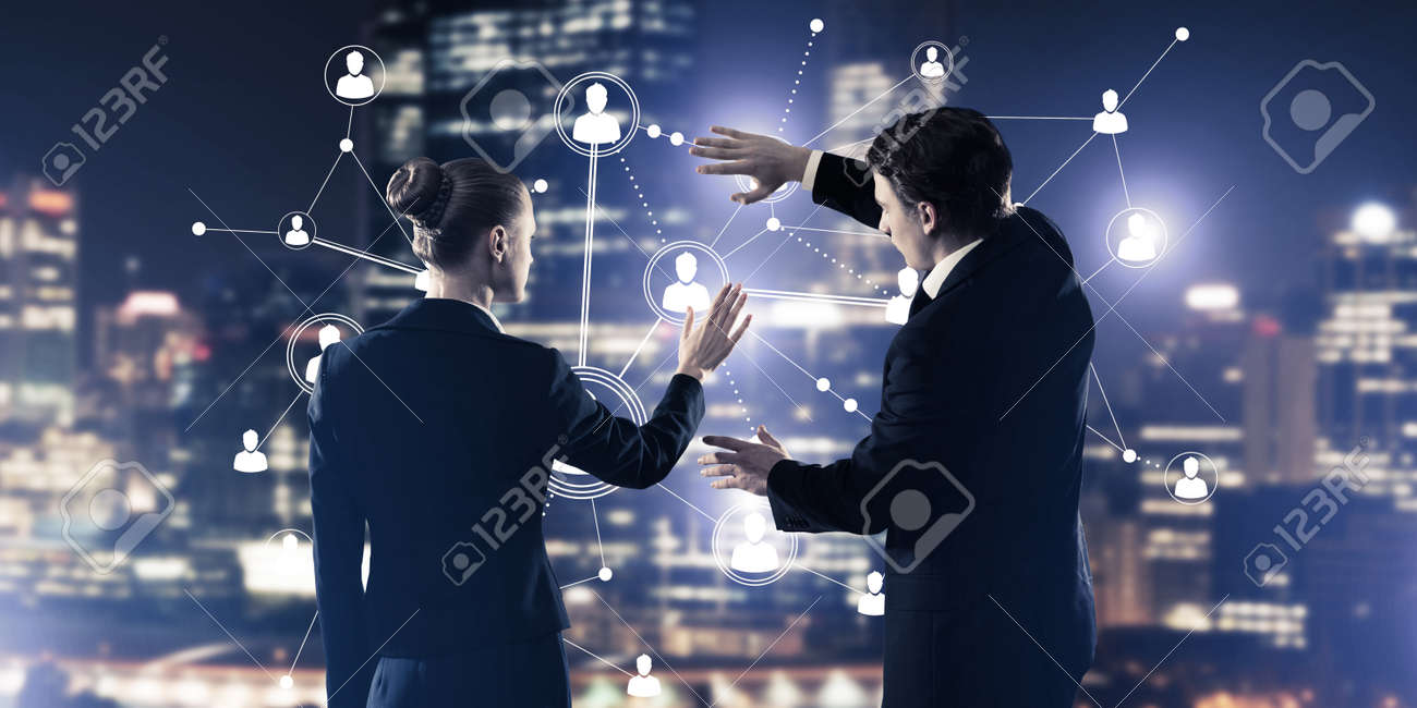 Businessman and businesswoman standing with back and touching connection concept - 129875857