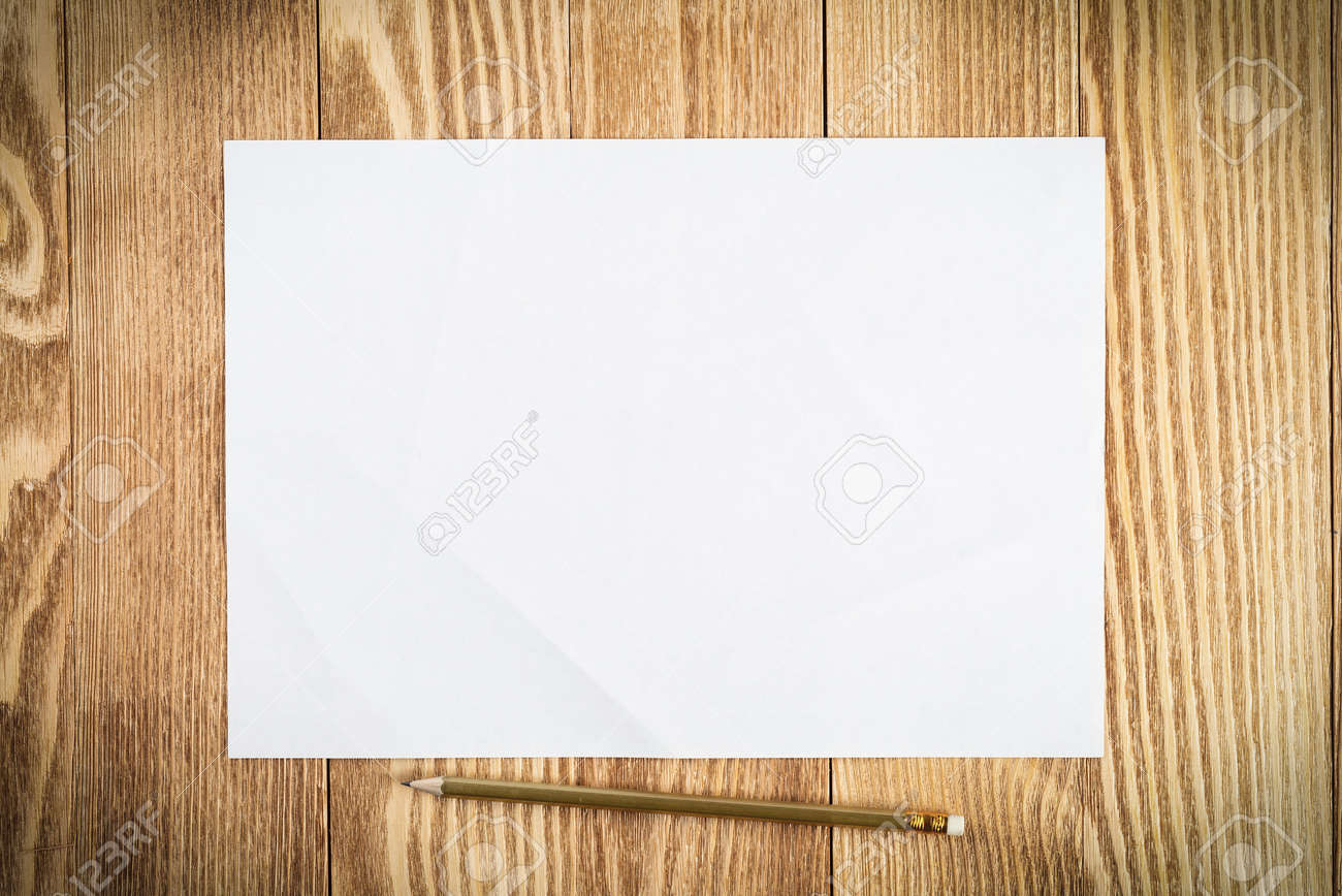 Sheet of paper lying on wooden table. Blank white a4 format paper with pencil. Space for writing and notification. Textured natural wooden background. Vintage copy space for creative design. - 133417495