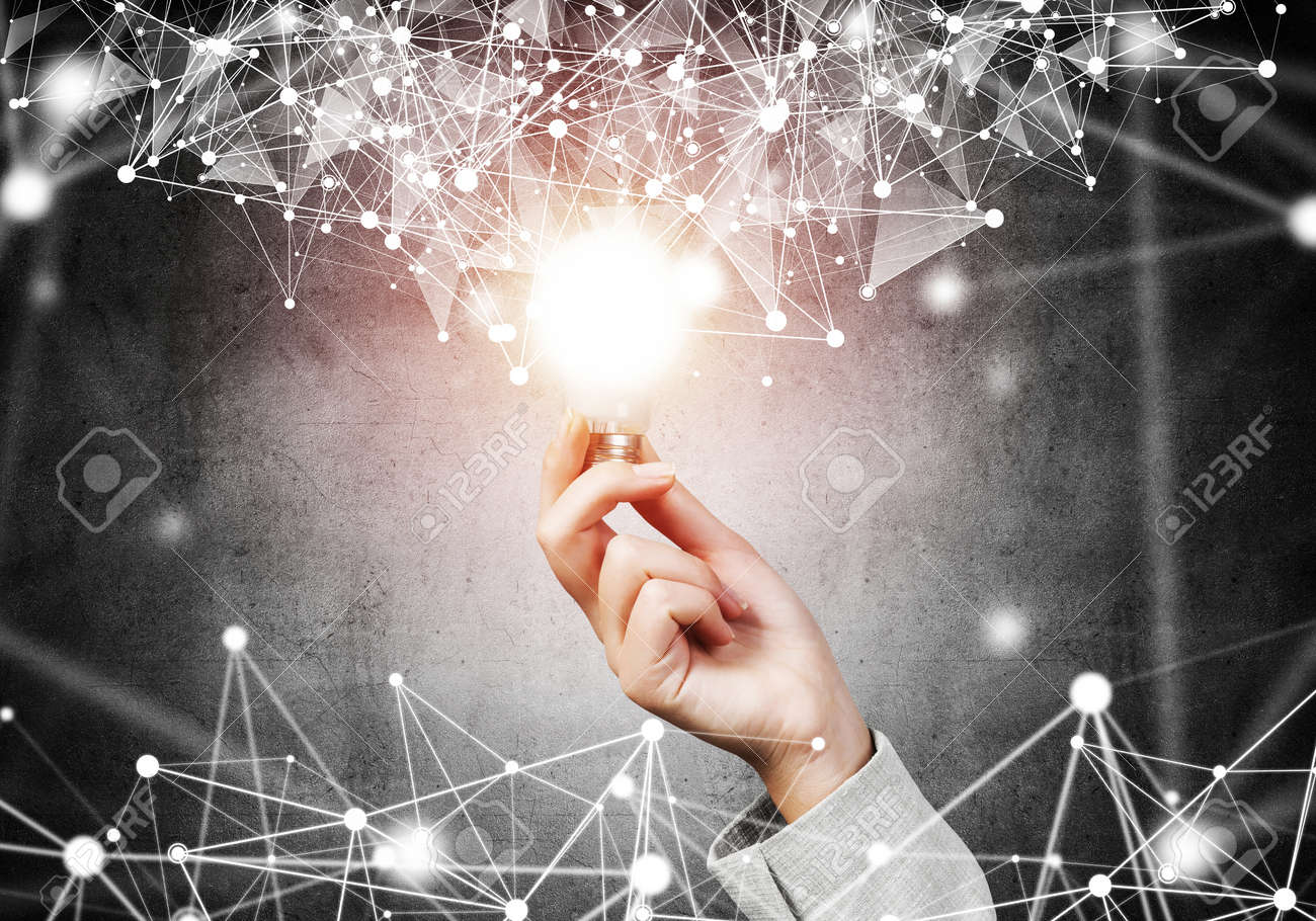 Woman hand with glowing lamp and abstract digital network connection on background of dark wall. Science research and innovation company. Global network technology and successful business solution. - 133426276