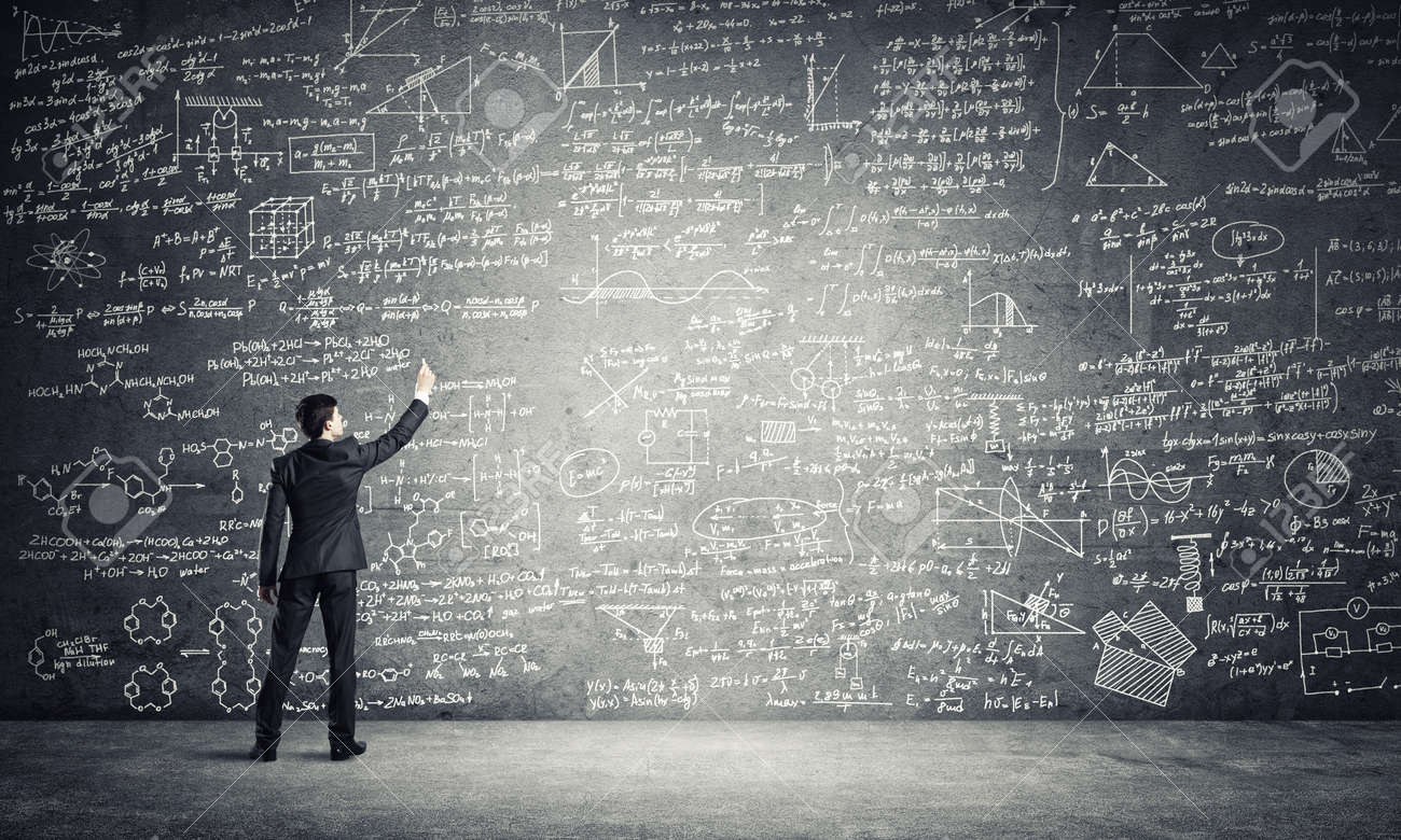 Businessman or teacher drawing science sketches at blackboard - 134860446