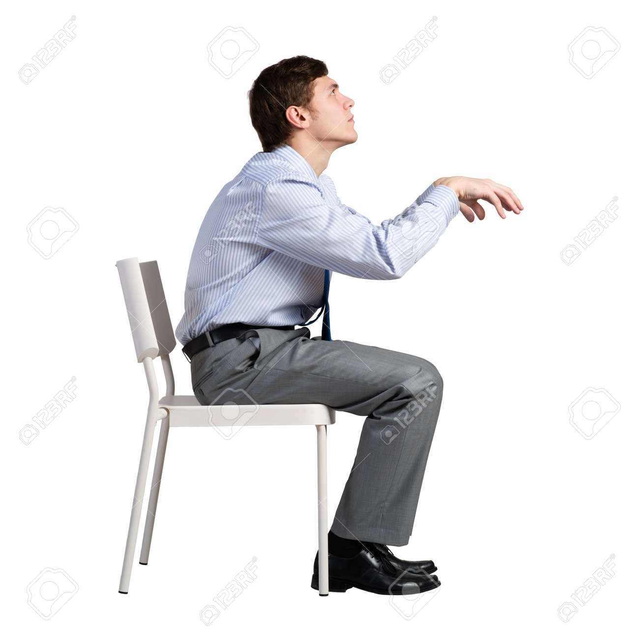 businessman sits on a chair, plays an imaginary piano - 167234795