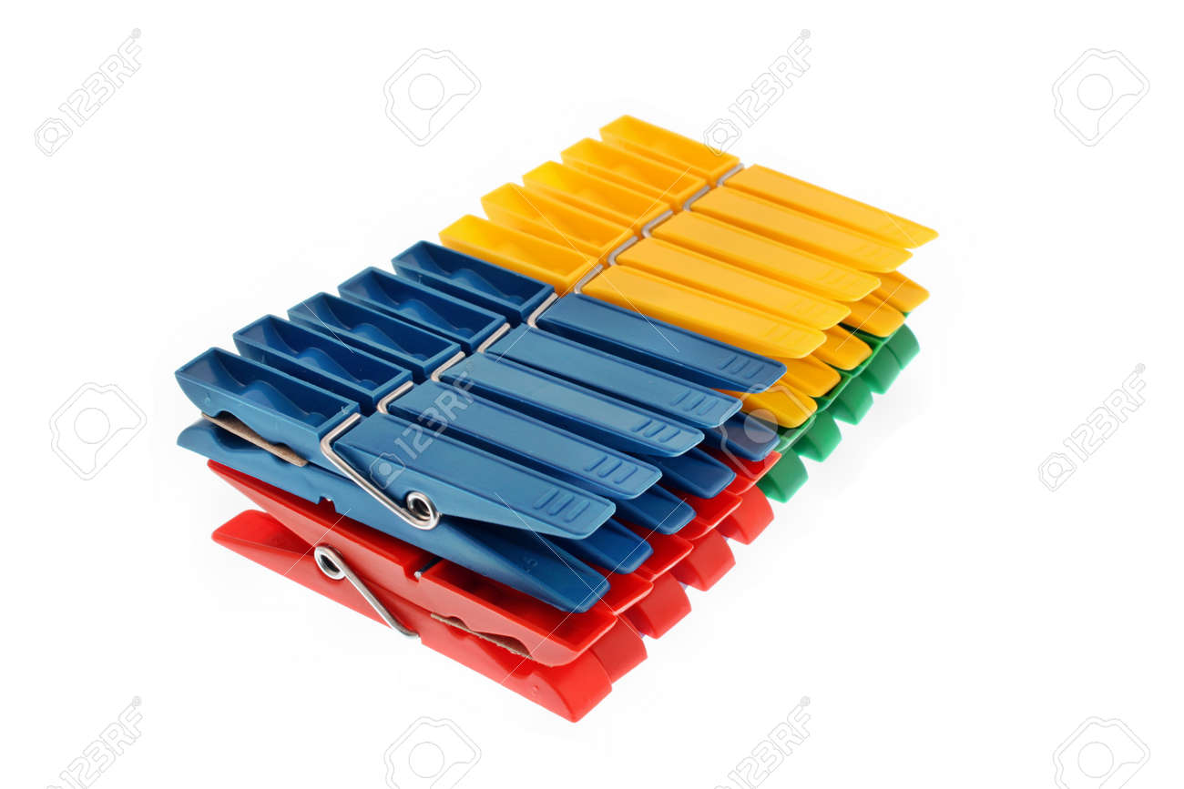 Colorful clothes pegs isolated Stock Photo - 21466836