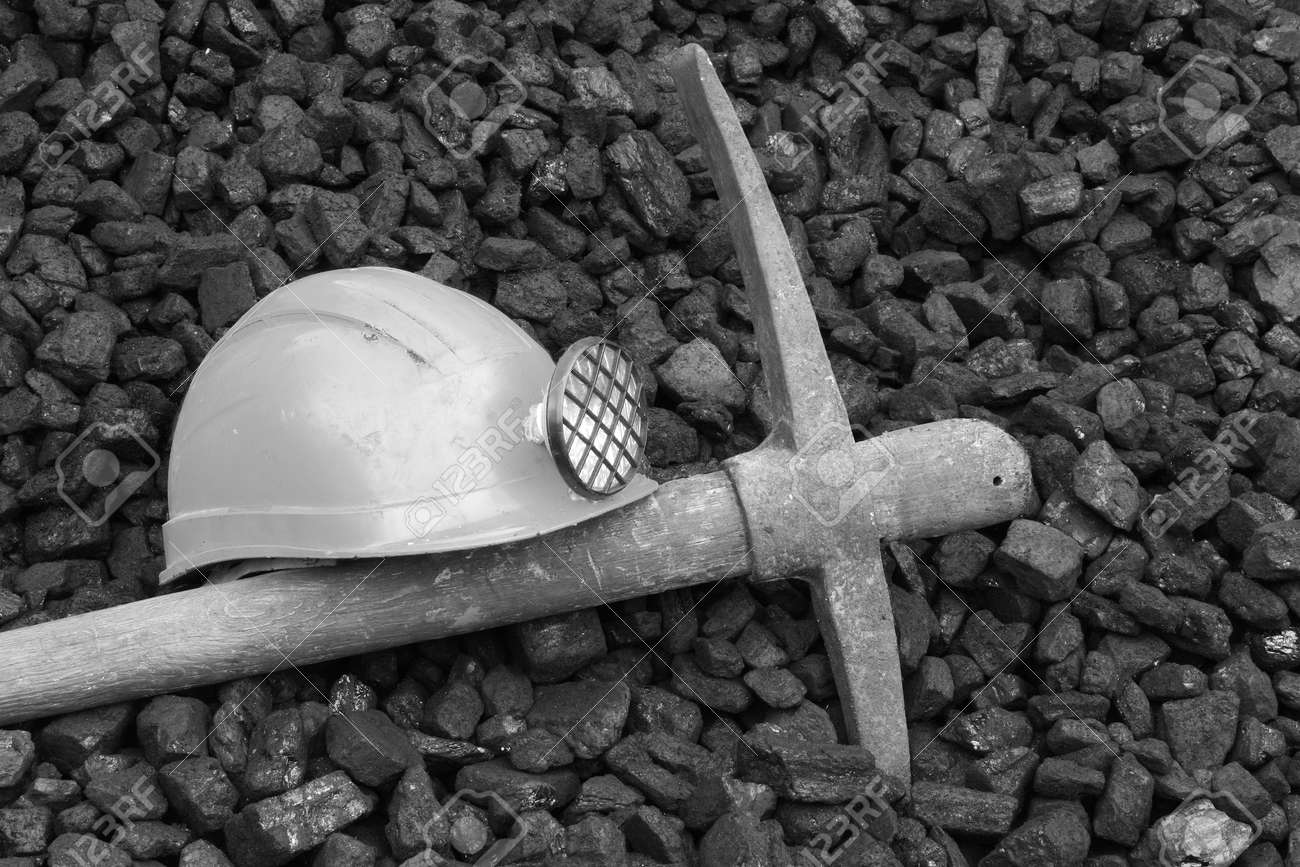 Photo helmet and pick commemorating the death of miners, black and white photo - 49180035