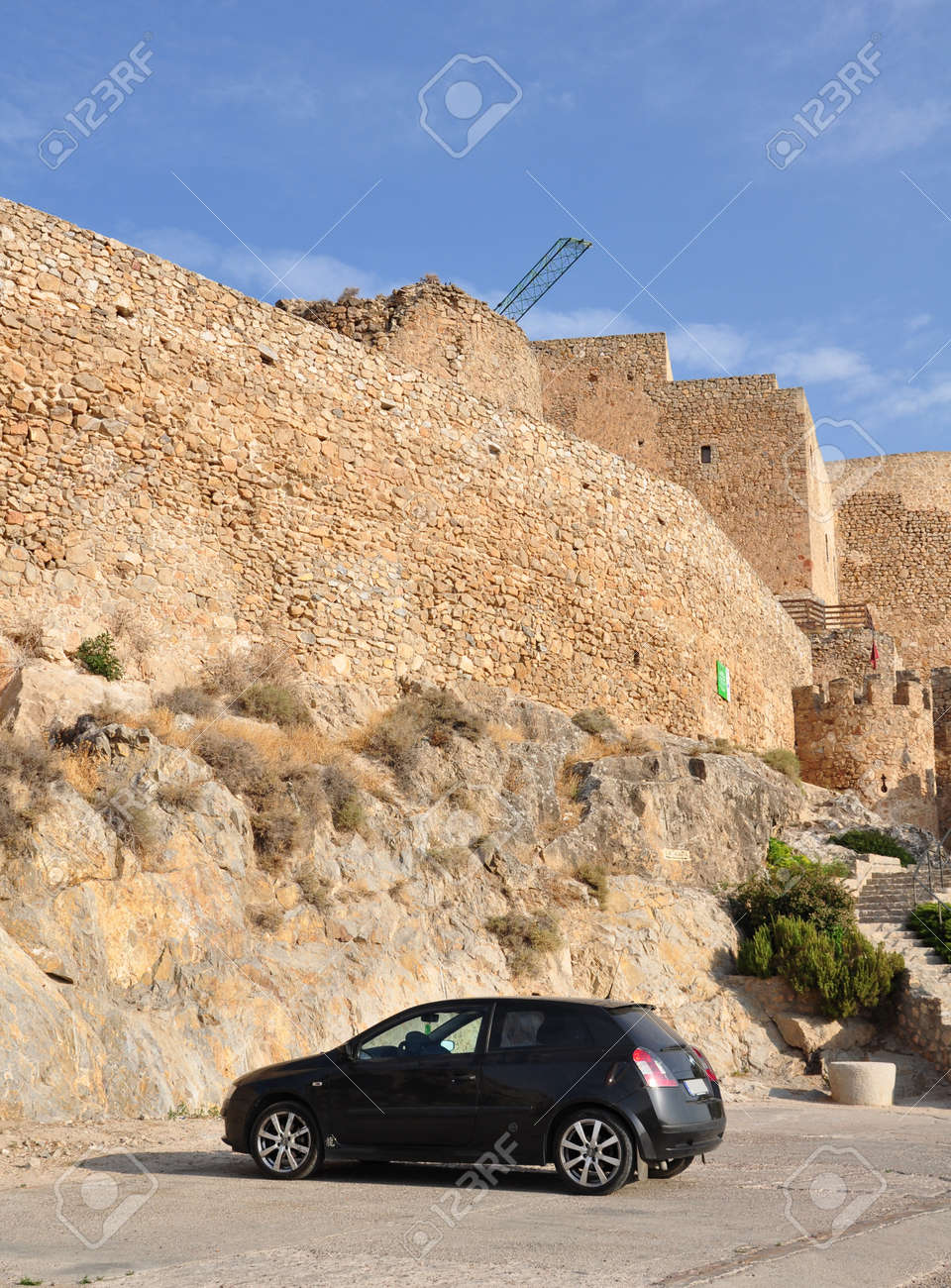 modern car parked in front of acient ruins Stock Photo - 15191883