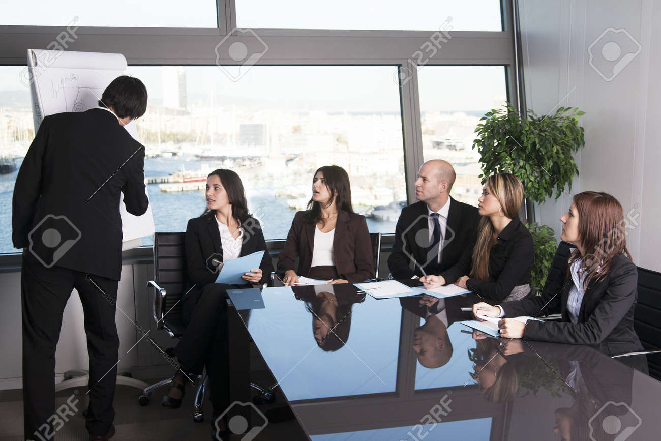 Group of office workers in a boardroom presentation Stock Photo - 12308375
