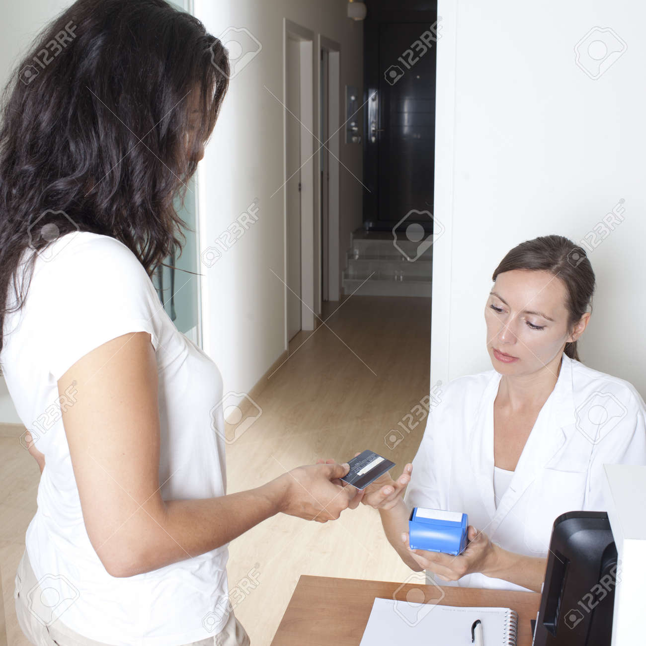 Patient paying for medical treatment with creditcard Stock Photo - 23404608
