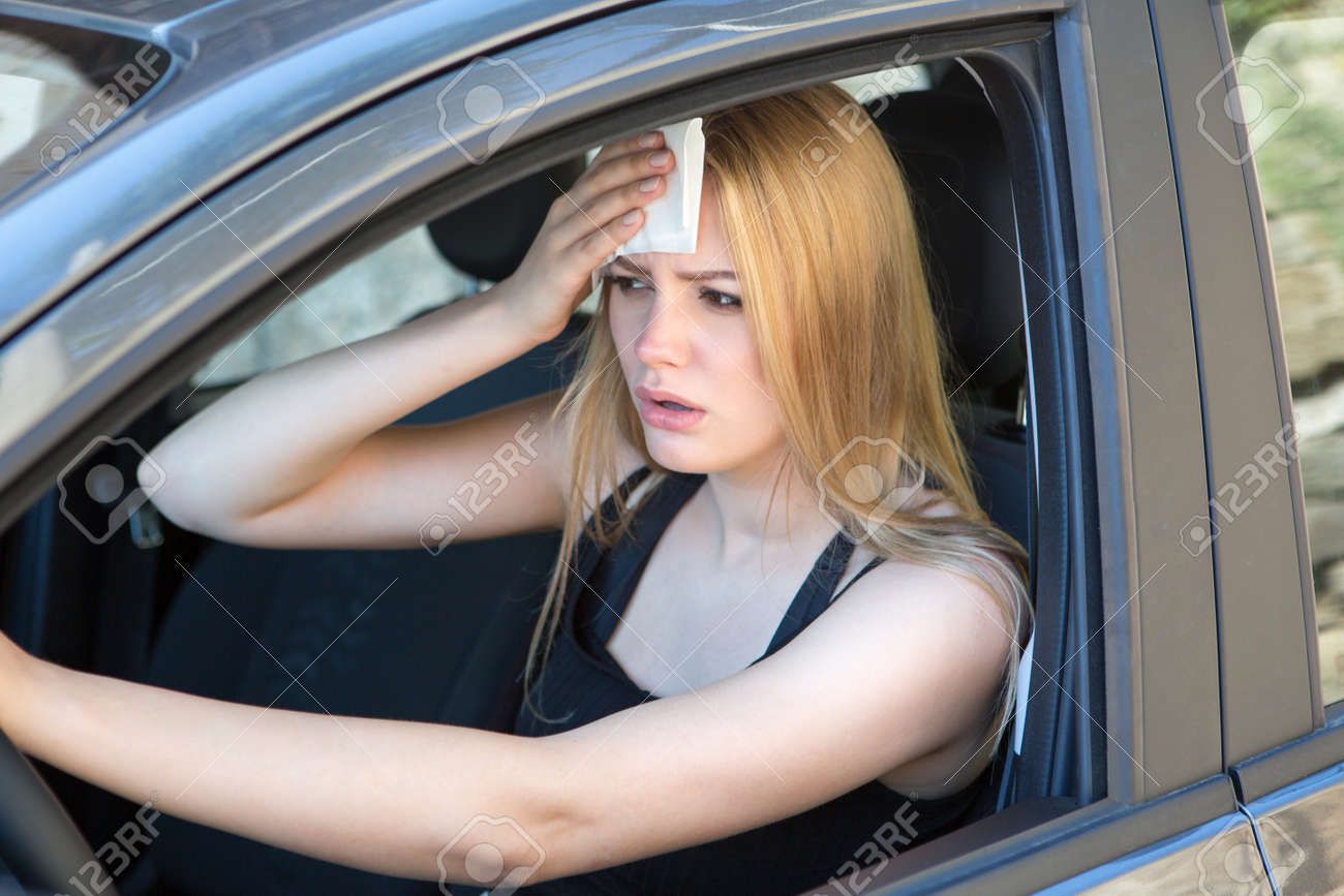 woman tired of heat in a car in summer - 103296100
