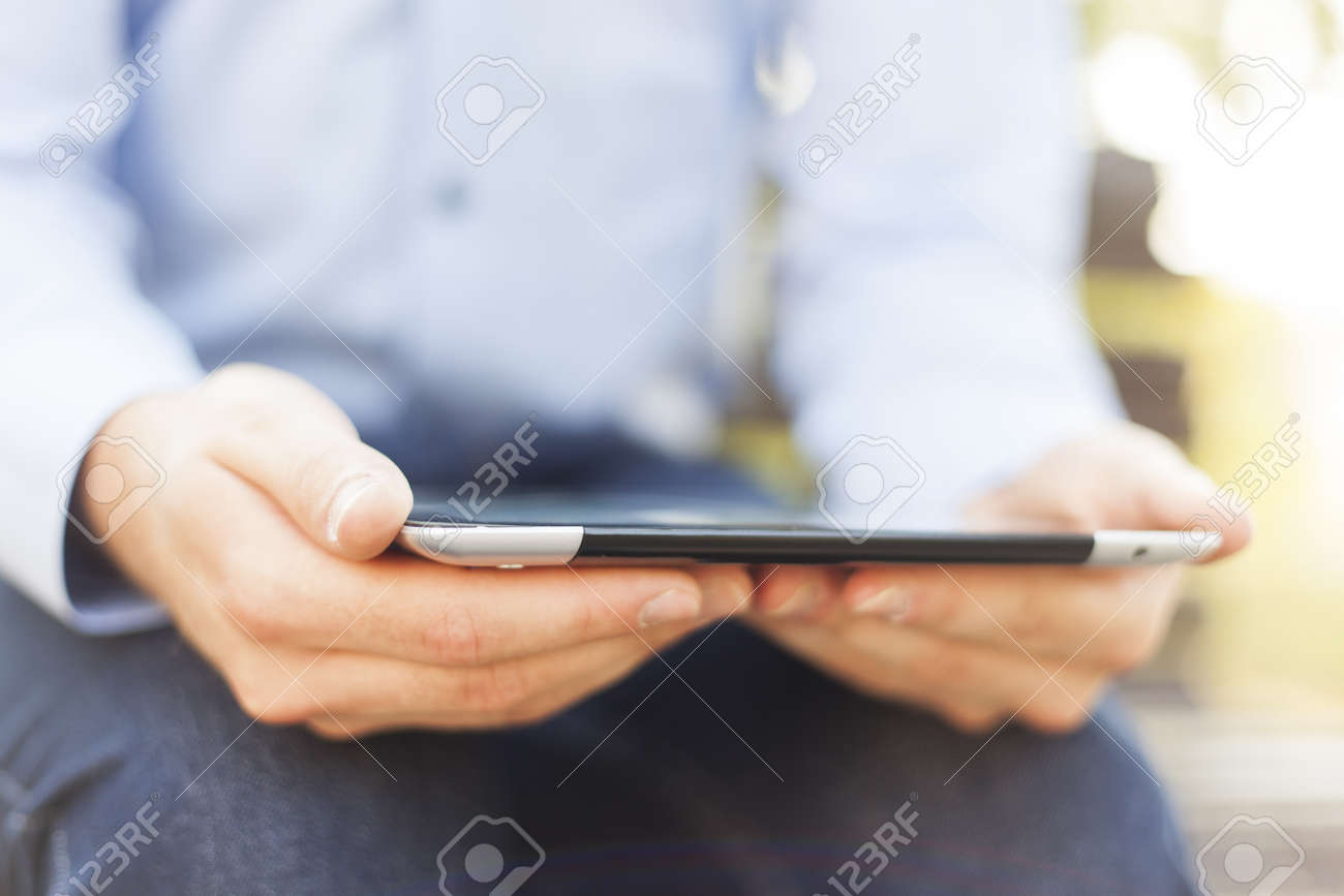 Businessman Reading News On Tablet Computer in park Stock Photo - 14445949